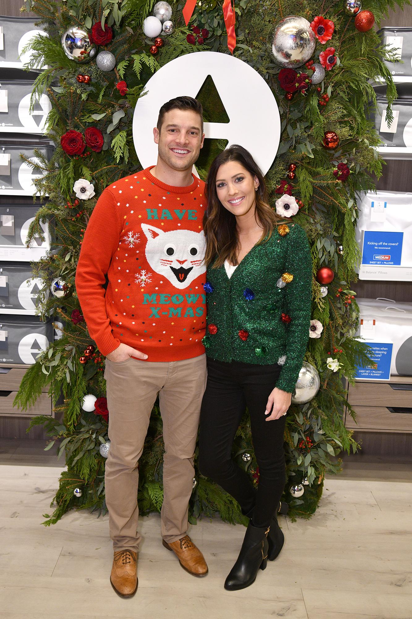 Becca Kufrin Garrett Yrigoyen Holidays - The Bachelorette couple wore festive holiday sweaters at an event in NYC.
