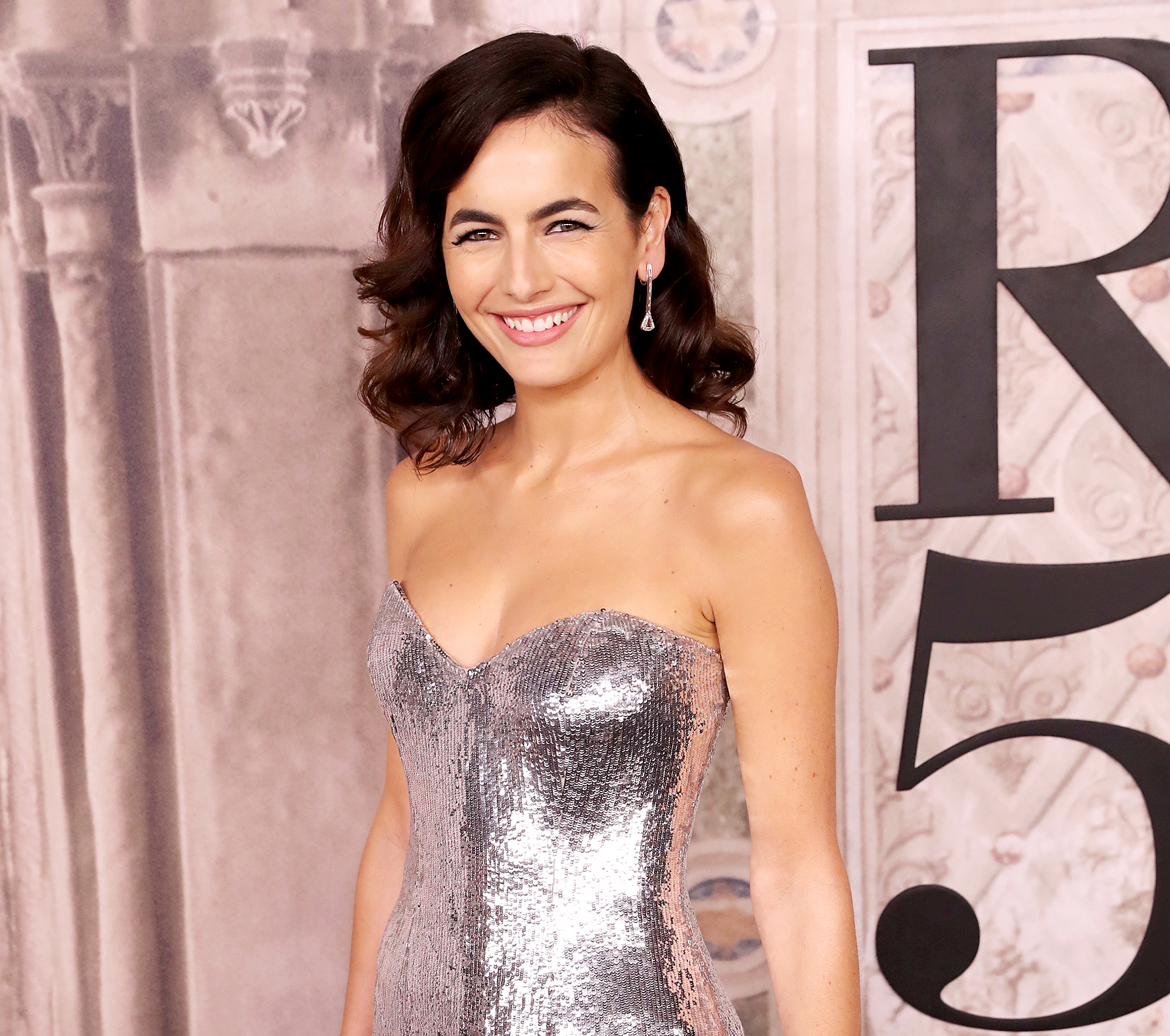 Camilla-Belle-golden-globes-cocktail - Camilla Belle attends the Ralph Lauren fashion show during New York Fashion Week at Bethesda Terrace on September 7, 2018 in New York City.