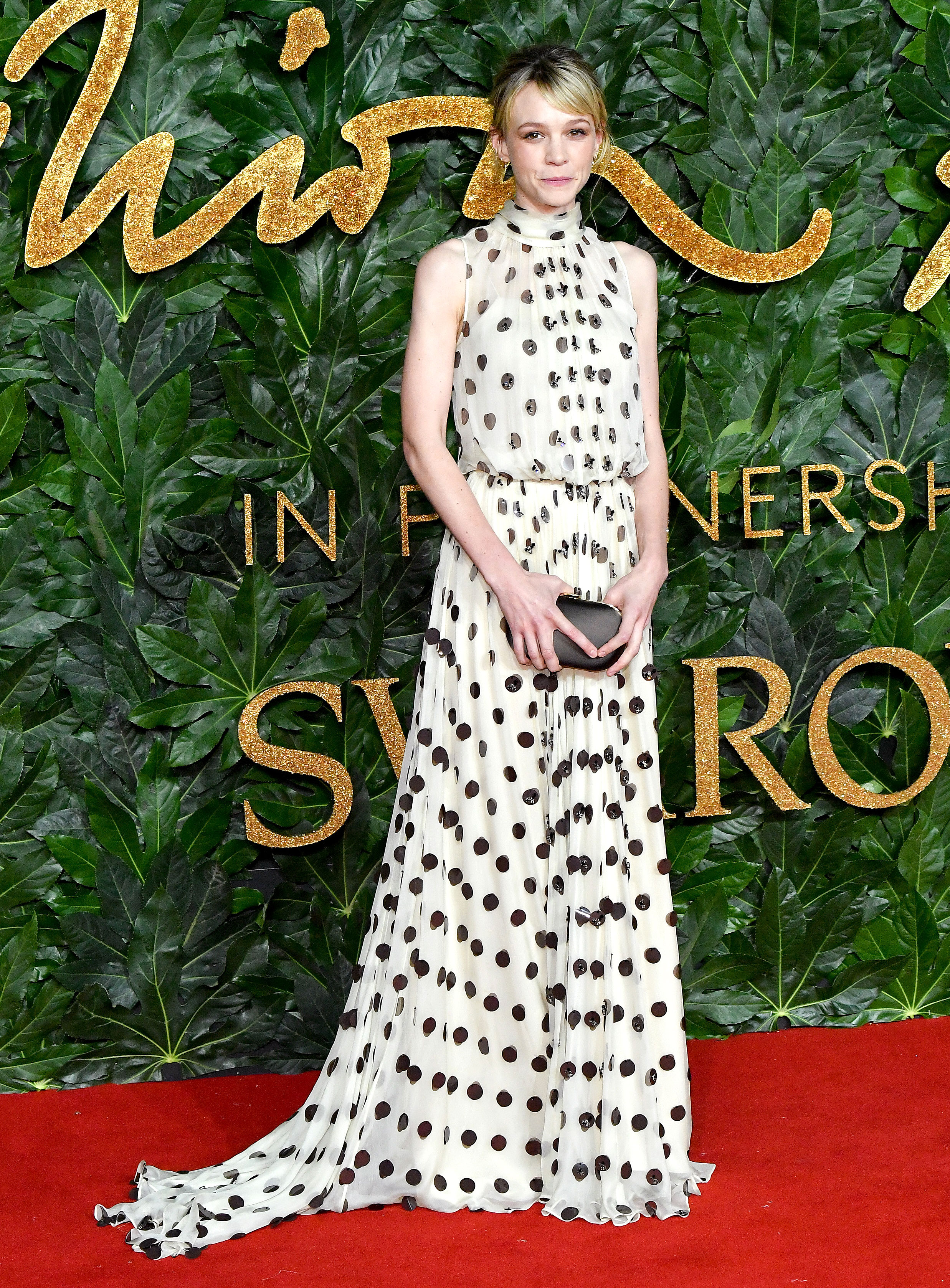Carey-Mulligan - Showing Us all how to transition one of the summer's biggest print trends into fall and winter, the actress rocked a polka dot Prada gown with EF Collection earrings.