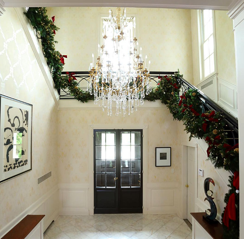 "stars go all out with holiday decorations gallery - ""Now that Thanksgiving is over, I can finally decorate for my favorite holiday...Christmas! @CasaZetaJones,"" the Chicago actress wrote alongside a photo that shows the foyer of the home she shares with husband Michael Douglas and their two children, Carys and Dyland, with green garlands strewn perfectly over the railing of her stairs."