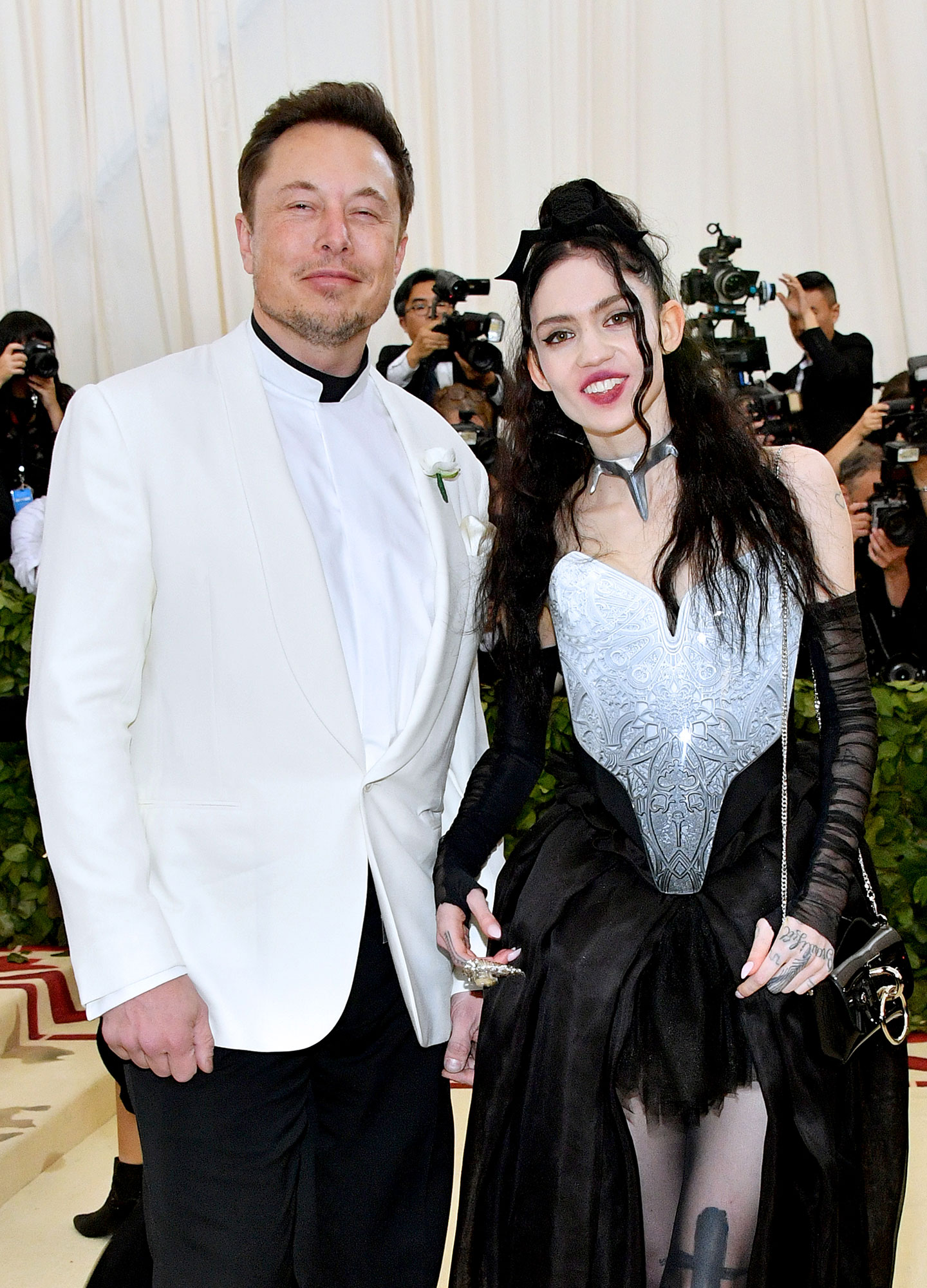 "Celebrity Couples of 2018 Elon Musk and Grimes - Fans were shocked when Musk and Grimes attended the 2018 Met Gala together in New York City in May. An insider told Us at the time that the duo had been ""dating for about a month."""