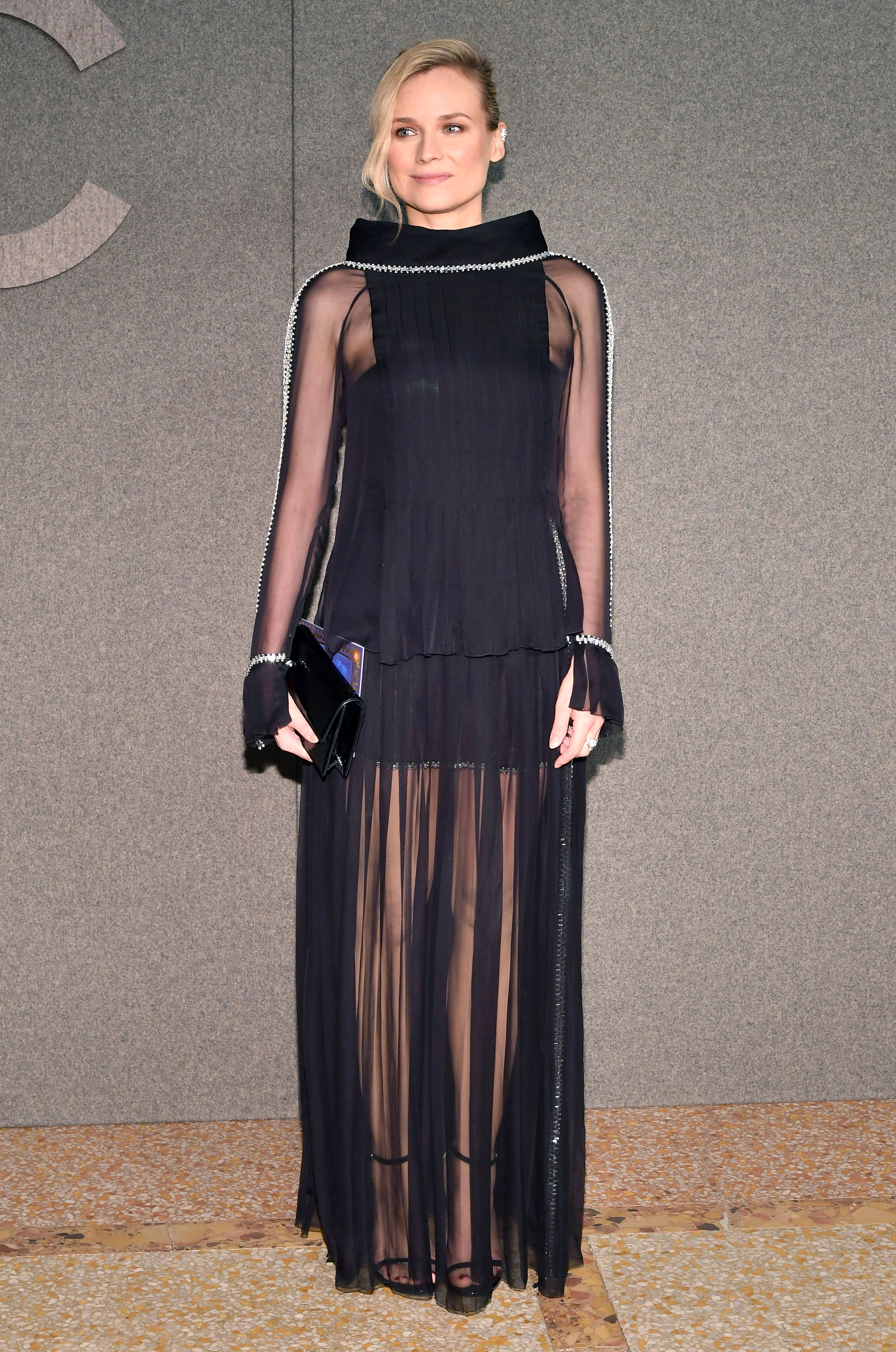 Diane-Kruger - It was the perfect illusion for the new mom in a black minidress with a sheer skit.