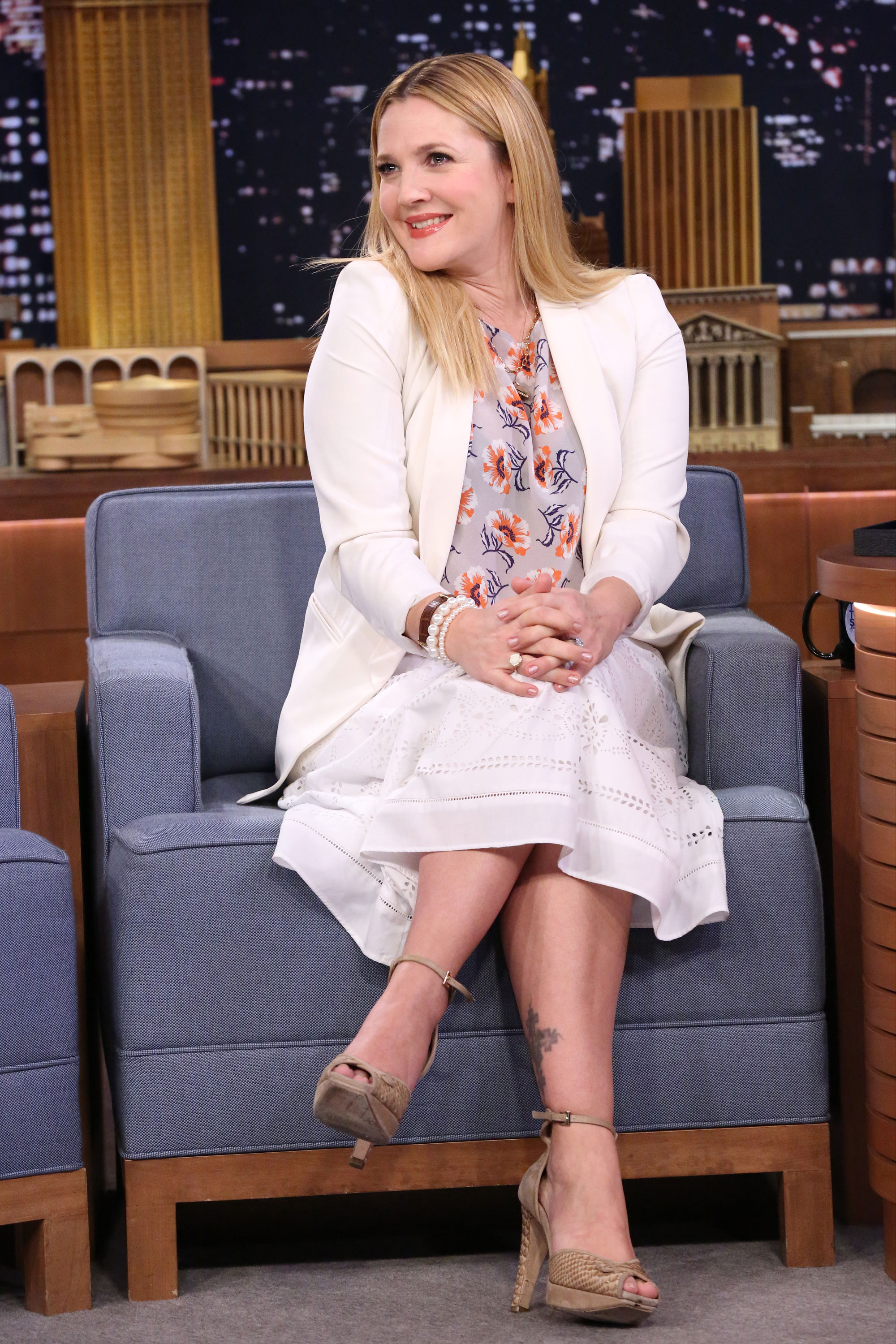 "Drew Barrymore's Body Through the Years - The Flower Beauty creator, who visited The Tonight Show Starring Jimmy Fallon seven months after welcoming her second daughter, Frankie, considers herself a realistic optimist. ""I like fun and empowerment and things that have some broader message of positivity,"" she has said."