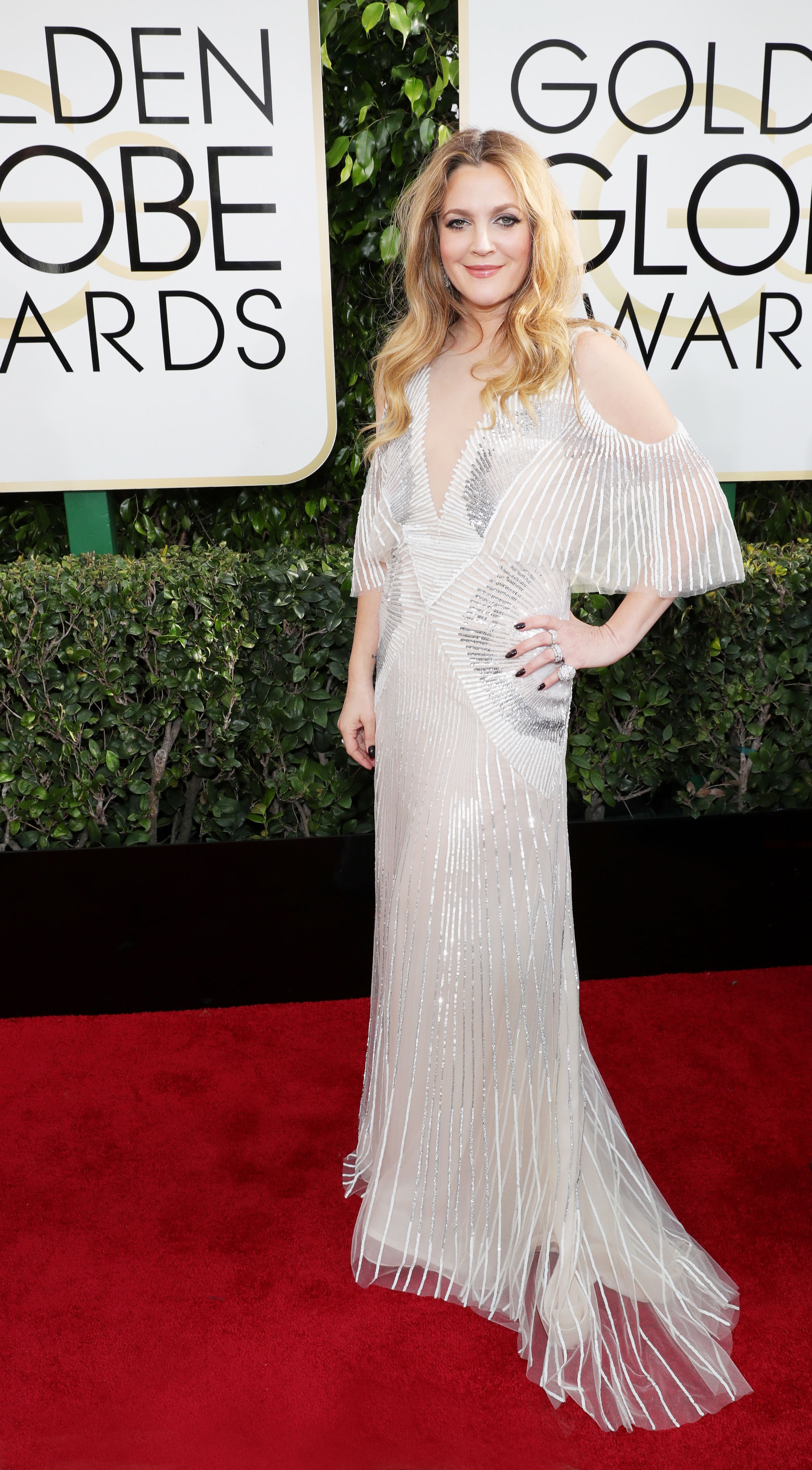"Drew Barrymore's Body Through the Years - Diet changes helped the actress (at the 2017 Golden Globes) drop about 20 pounds in 2017. ""I feel really great. I followed [nutritionist] Kimberly Snyder's methods, but I added some protein like fish and chicken since she's all vegetarian or vegan,"" she told Us at the time."
