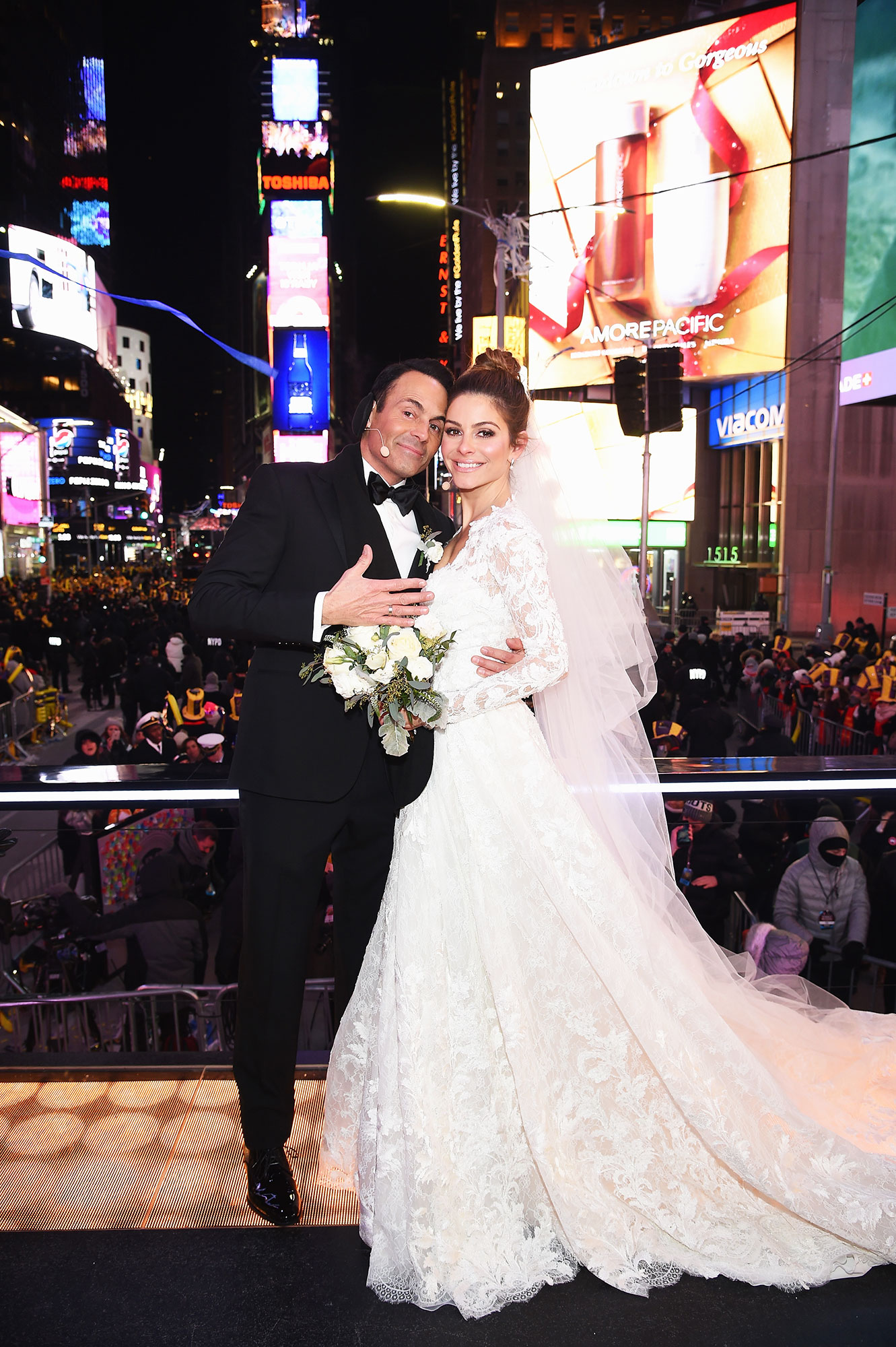 Every Star Who Got Married on New Year's Eve - Keven Undergaro (L) and Maria Menounos hold their wedding ceremony during Maria Menounos and Steve Harvey Live from Times Square at Marriott Marquis Times Square on December 31, 2017 in New York City.