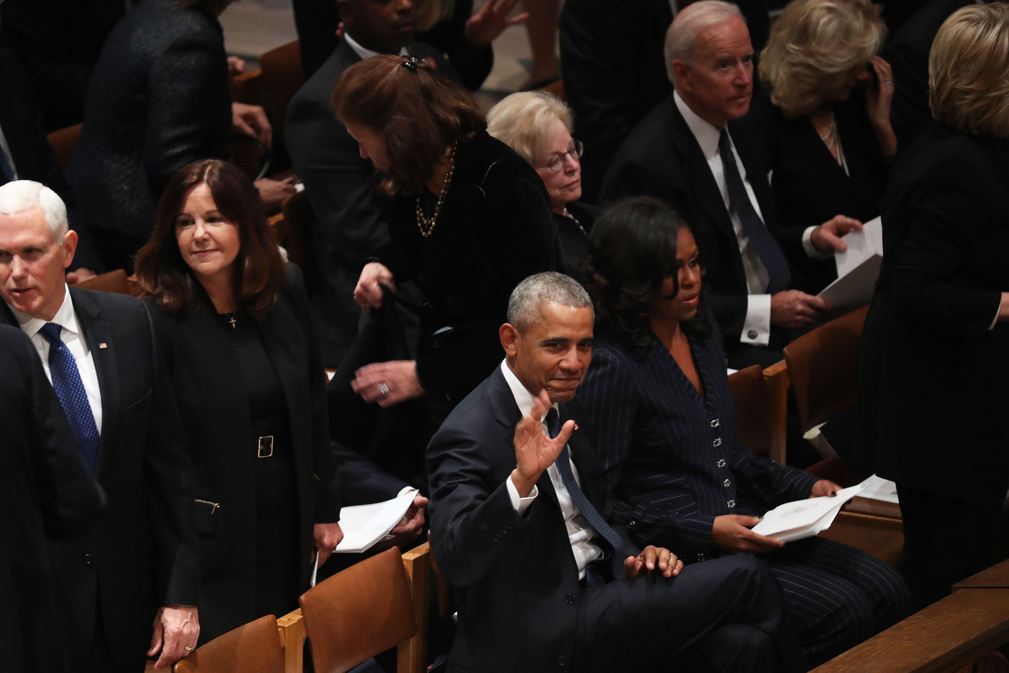 """george bush funeral - George W. passed the former first lady a piece of candy during Wednesday's service, just like he did at Senator John McCain's funeral in August. """"He is my partner in crime at every major thing where all the 'formers' gather,"""" Michelle said on the Today show in October after the moment went viral."""