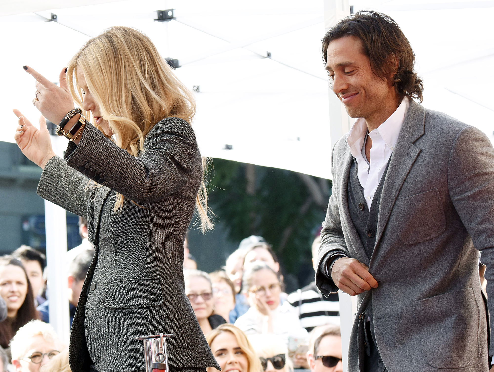 Gwyneth Paltrow Brad Falchuk Praise Ryan Murphy For Introducing Them - Paltrow — showing off a glimpse of her wedding ring — and Falchuk looked in sync while rocking gray suits at the event.
