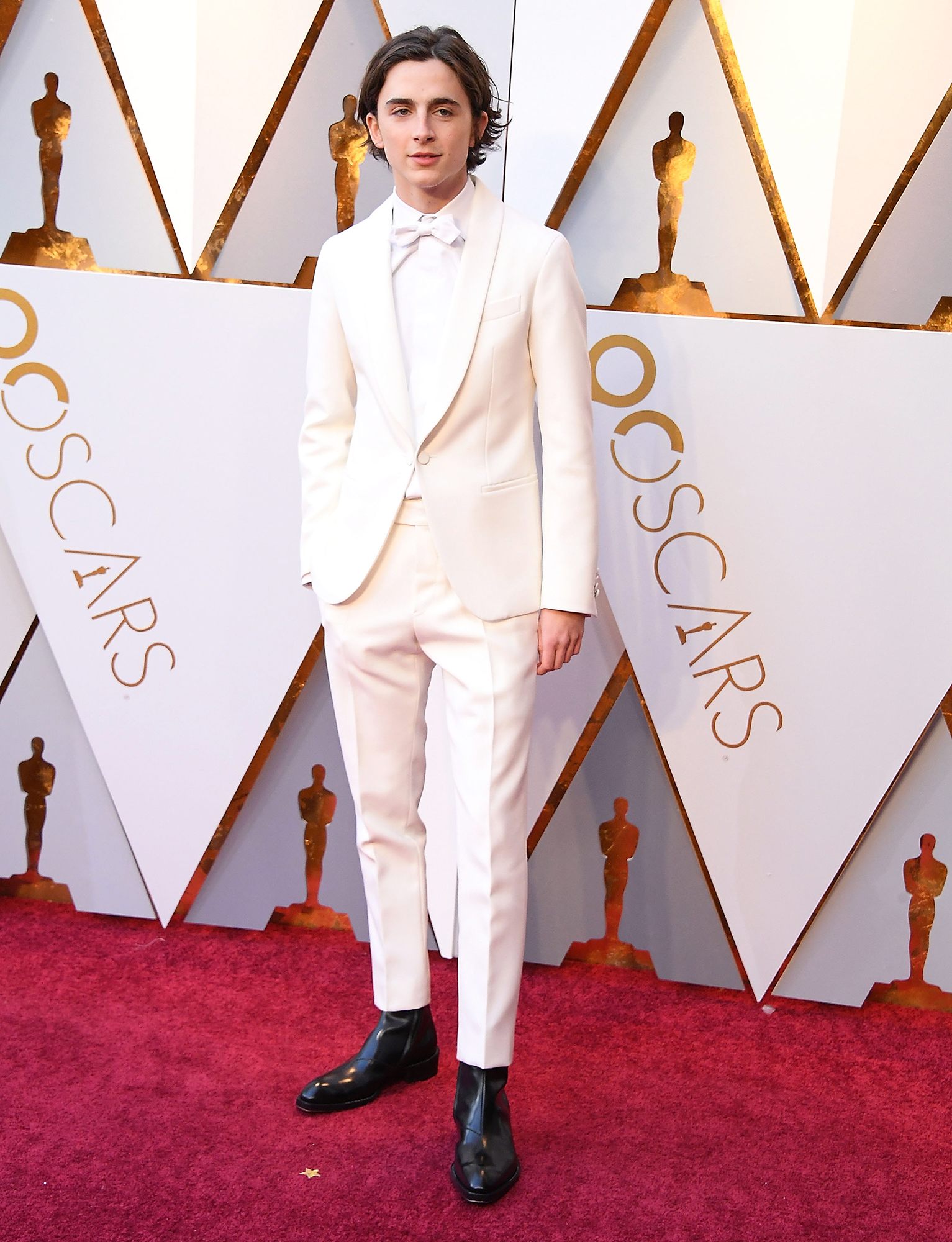 Hottest Guys in Suits - 2018 Edition - All white everything was the name of the game for the Call Me By Your Name star in a Berluti suit at the Oscars.