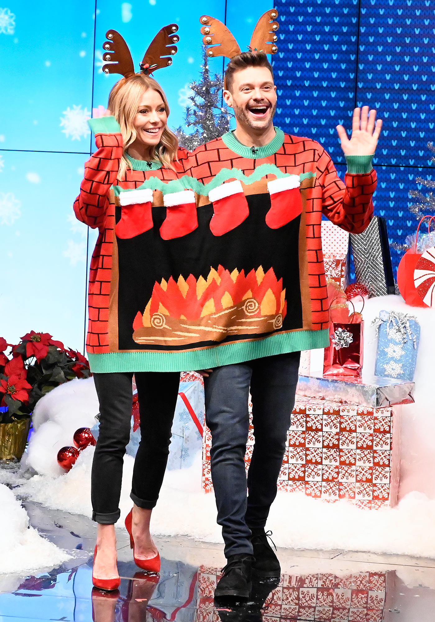 Kelly Ripa Ryan Seacrest Ugly Christmas Sweater - The Live With Kelly and Ryan cohosts took the ugly sweater game to the next level.