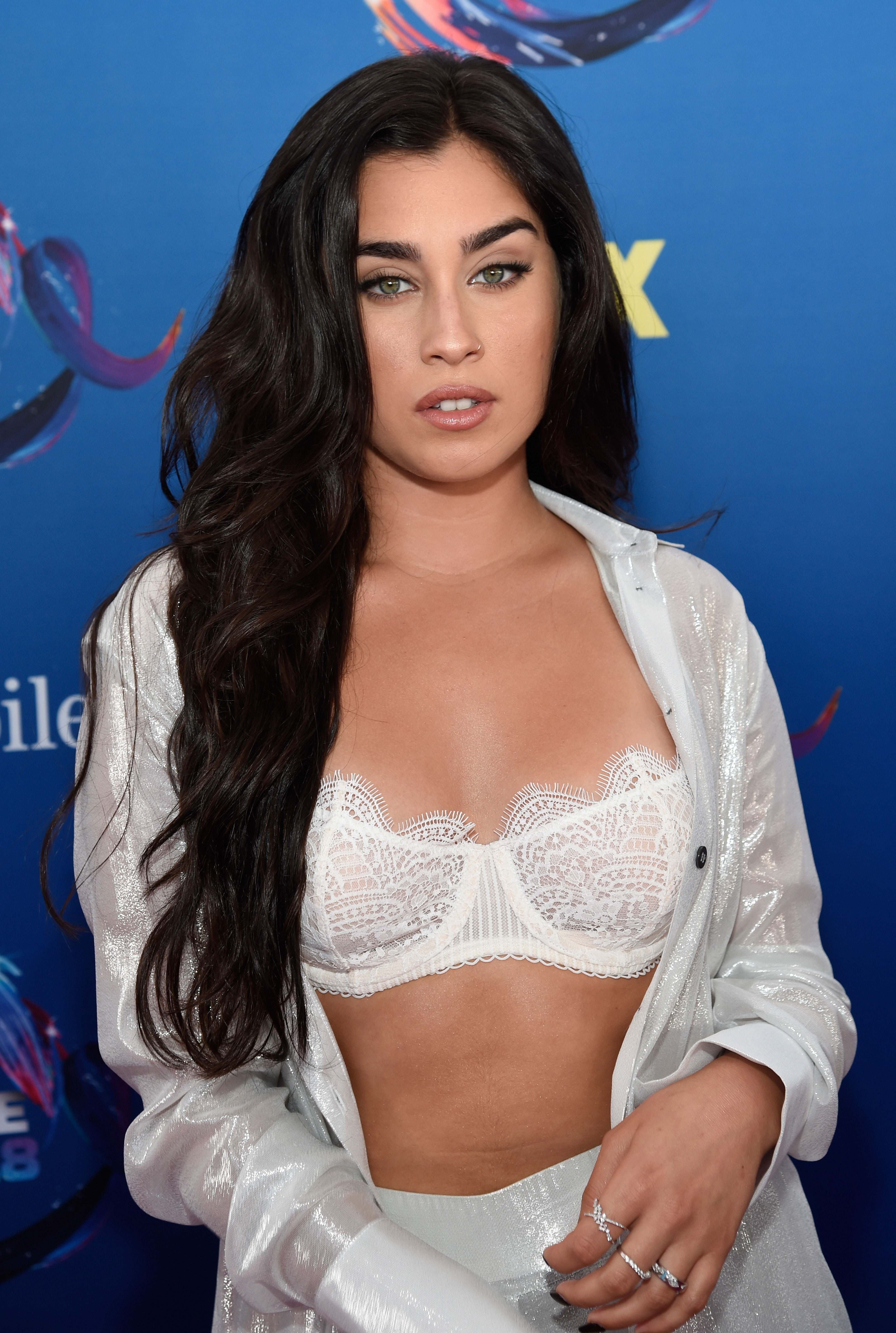 """Santa's Naughty or Nice List - """"I'm on both because I'm spicy but nice, you know what I mean? Sometimes I do some naughty s--t, but most of the time I'm very kind. I give grace and love everywhere I go,"""" the former Fifth Harmony singer tells Us . """"So I hope to be on both lists and get a couple cute things."""""""