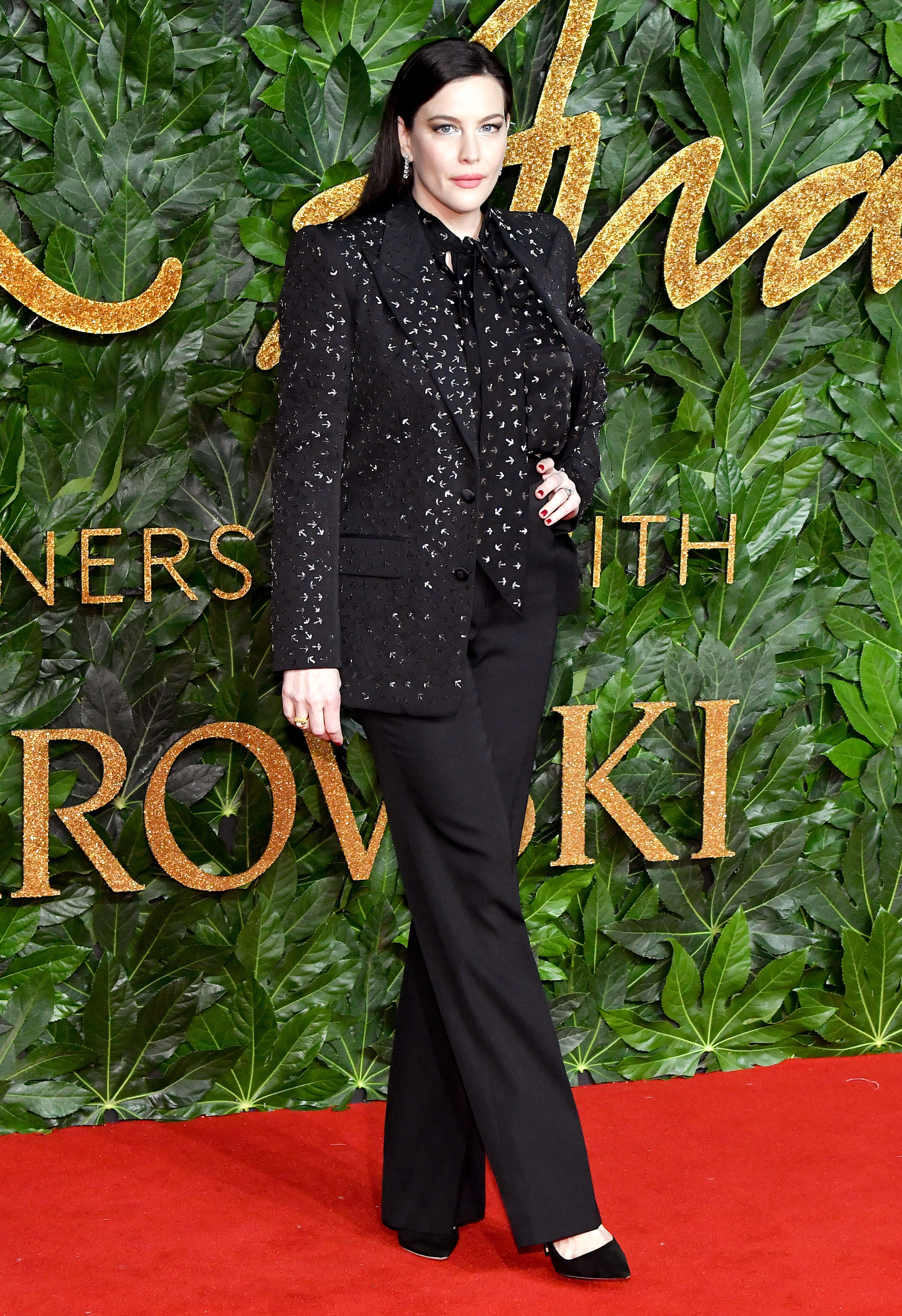 Liv-Tyler - The actress was suited up in a sparkling black blazer and matching top.
