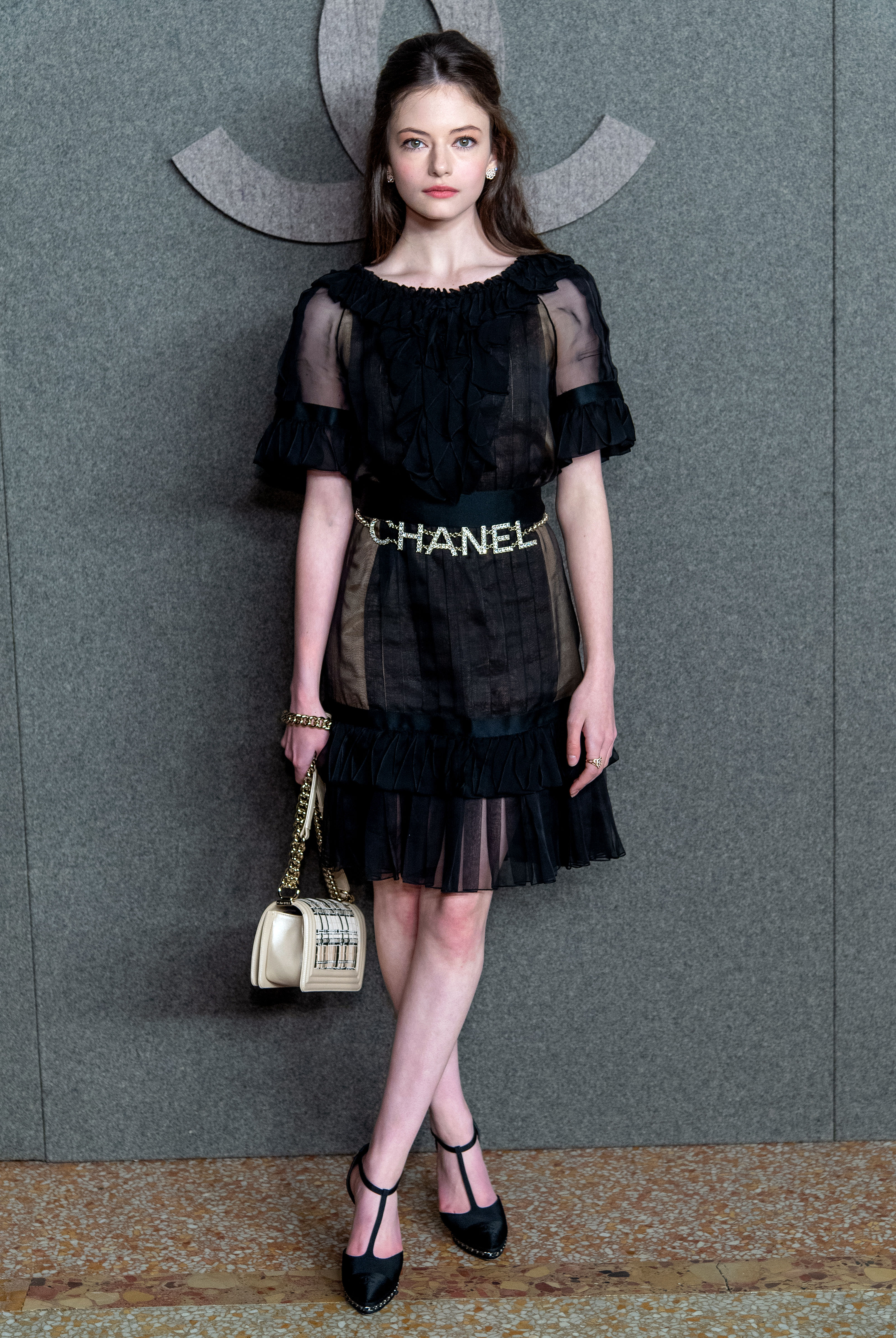Mackenzie-Foy- - It was all about the logo love for the Nutcracker and the Four Realms actress in a sheer black dress and a sparkly Chanel belt.