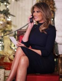 Melania Trump Christmas Eve manning the phones of the NORAD Santa tracker in a navy blue Ralph Lauren turtleneck dress