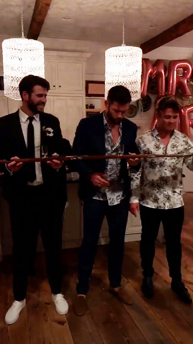 Miley Cyrus Liam Hemsworths Secret Wedding - Liam and his brothers, Chris Hemsworth and Luke Hemsworth , commemorated the occasion with a shot ski.