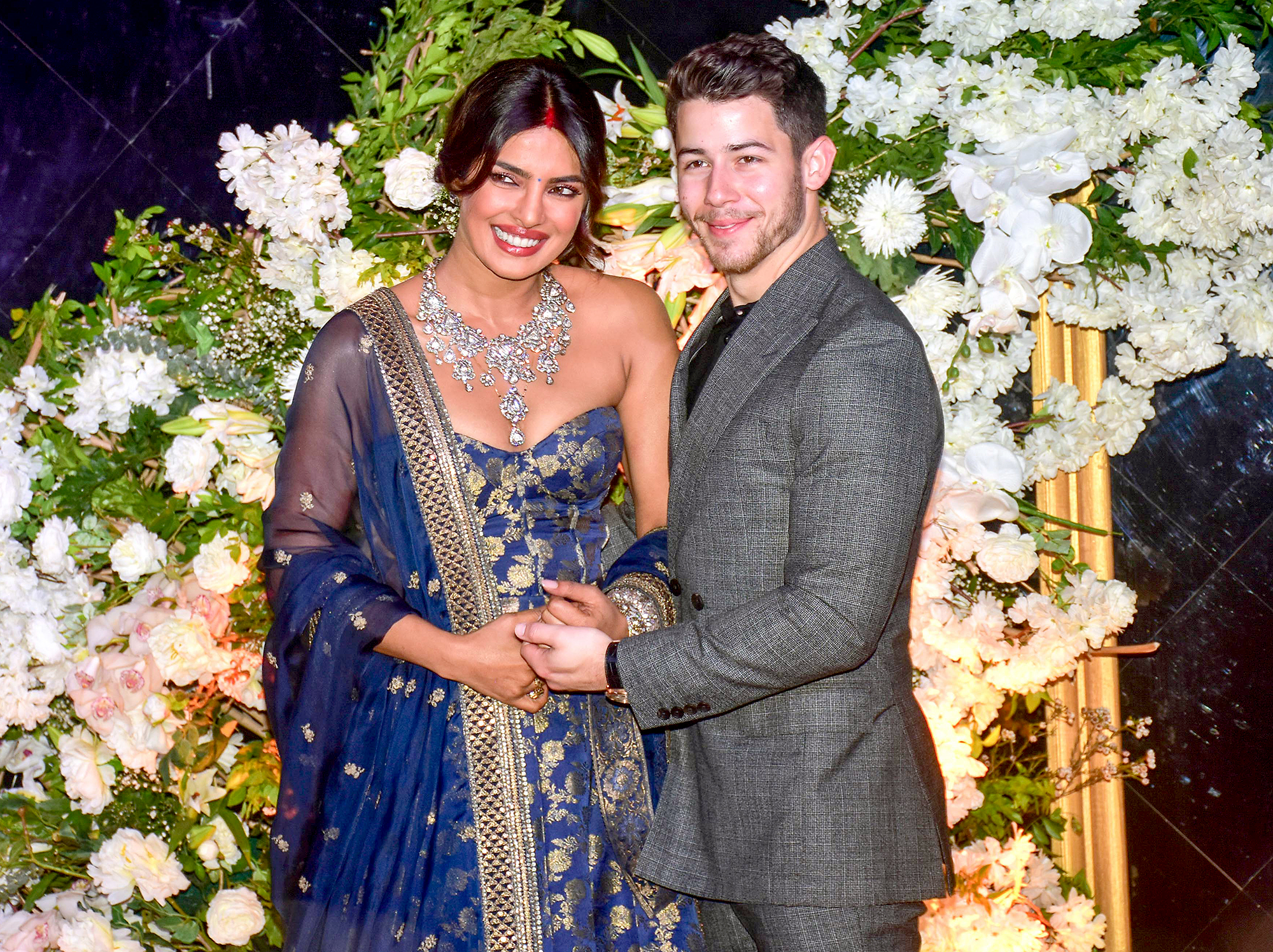 Nick-Jonas-and-Priyanka-Chopra-Mumbai-Wedding-Reception - The duo were all smiles as they held hands during the reception.