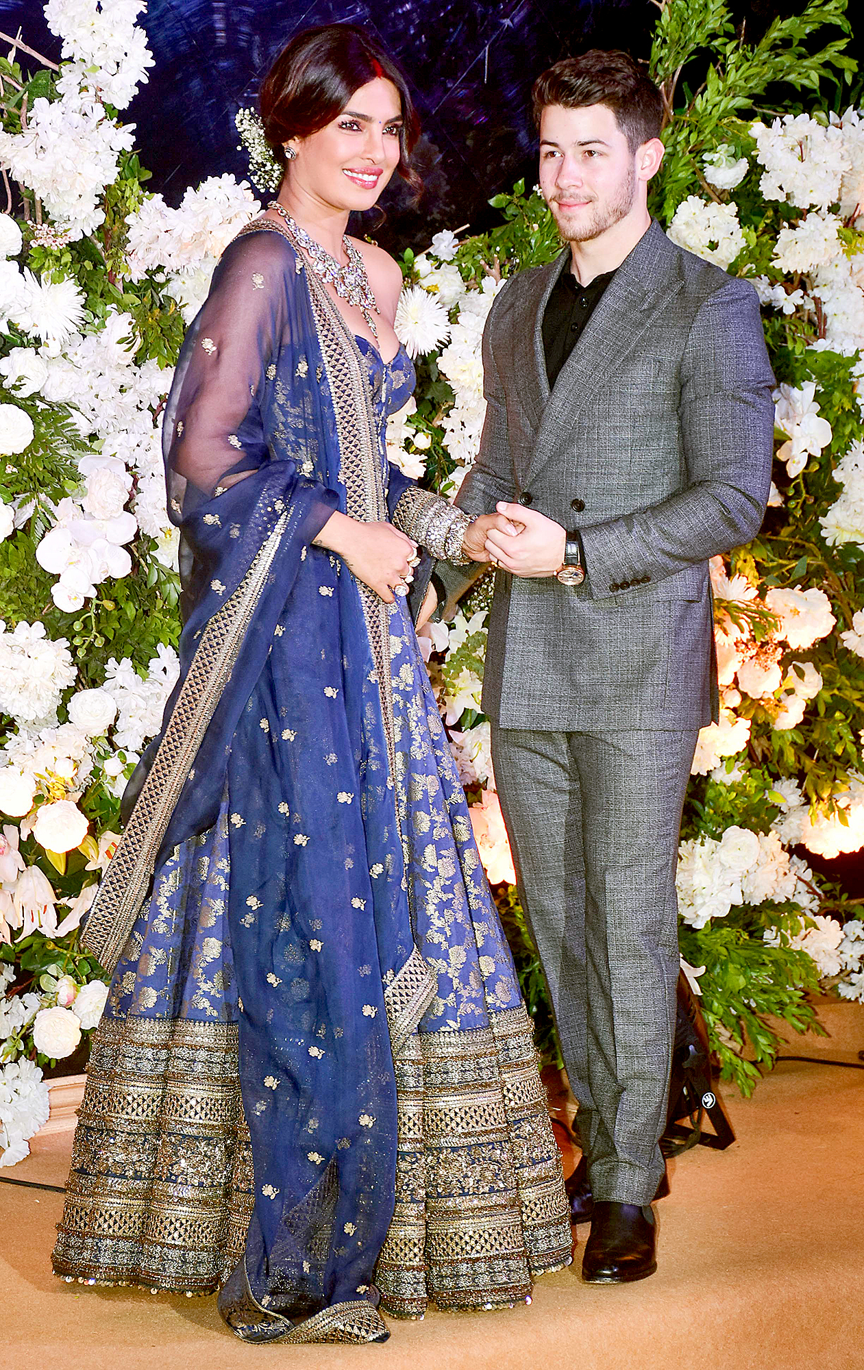 Nick-Jonas-and-Priyanka-Chopra-Mumbai-Wedding-Reception - The pair's wedding festivities kicked off on November 28 with a traditional Puja ceremony to honor their union. On November 30, they hosted a Sangeet, a traditional pre-wedding celebration with dance and music.