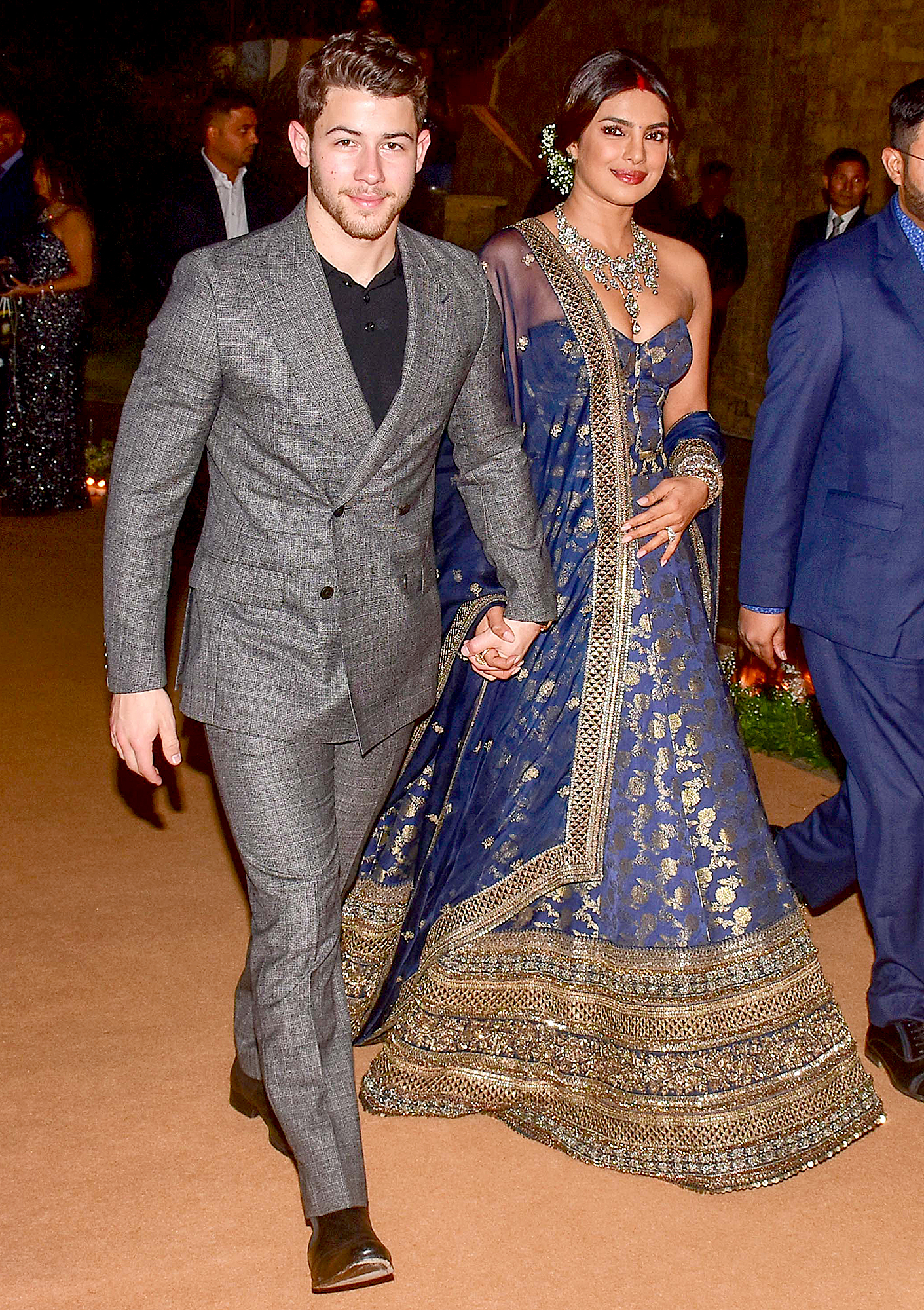 Nick-Jonas-and-Priyanka-Chopra-Mumbai-Wedding-Reception - MUMBAI, INDIA – 2018/12/19: Indian actress Priyanka Chopra with her husband US musician Nick Jonas are seen during their wedding reception at the hotel JW Marriott in Mumbai. (Photo by Azhar Khan/SOPA Images/LightRocket via Getty Images)