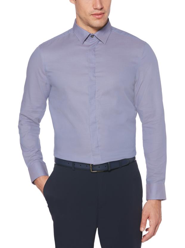 a light blue perry ellis dress shirt on a guy model wearing dark pants and a belt