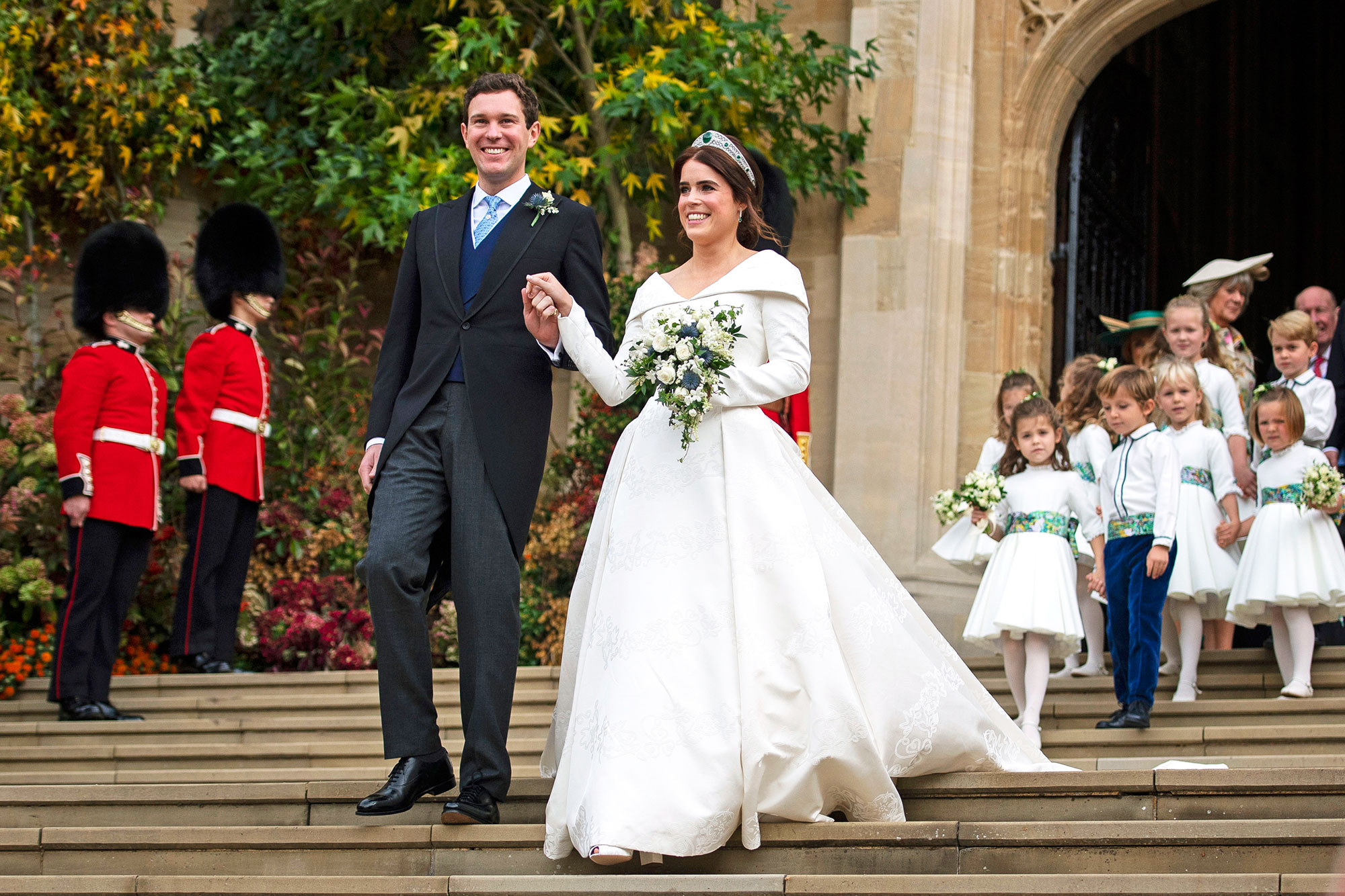 Princess Eugenie The Year in Love: The 11 Best Celebrity Wedding Dresses of 2018 - At the second royal wedding of the year at St George Chapel at Windsor Castle, Prince Andrew and the Duchess of York's youngest daughter tied the knot with Jack Brooksbank on October 12 in a custom long-sleeve Peter Pilotto gown that was specifically designed to show off a scar she has from a back surgery.