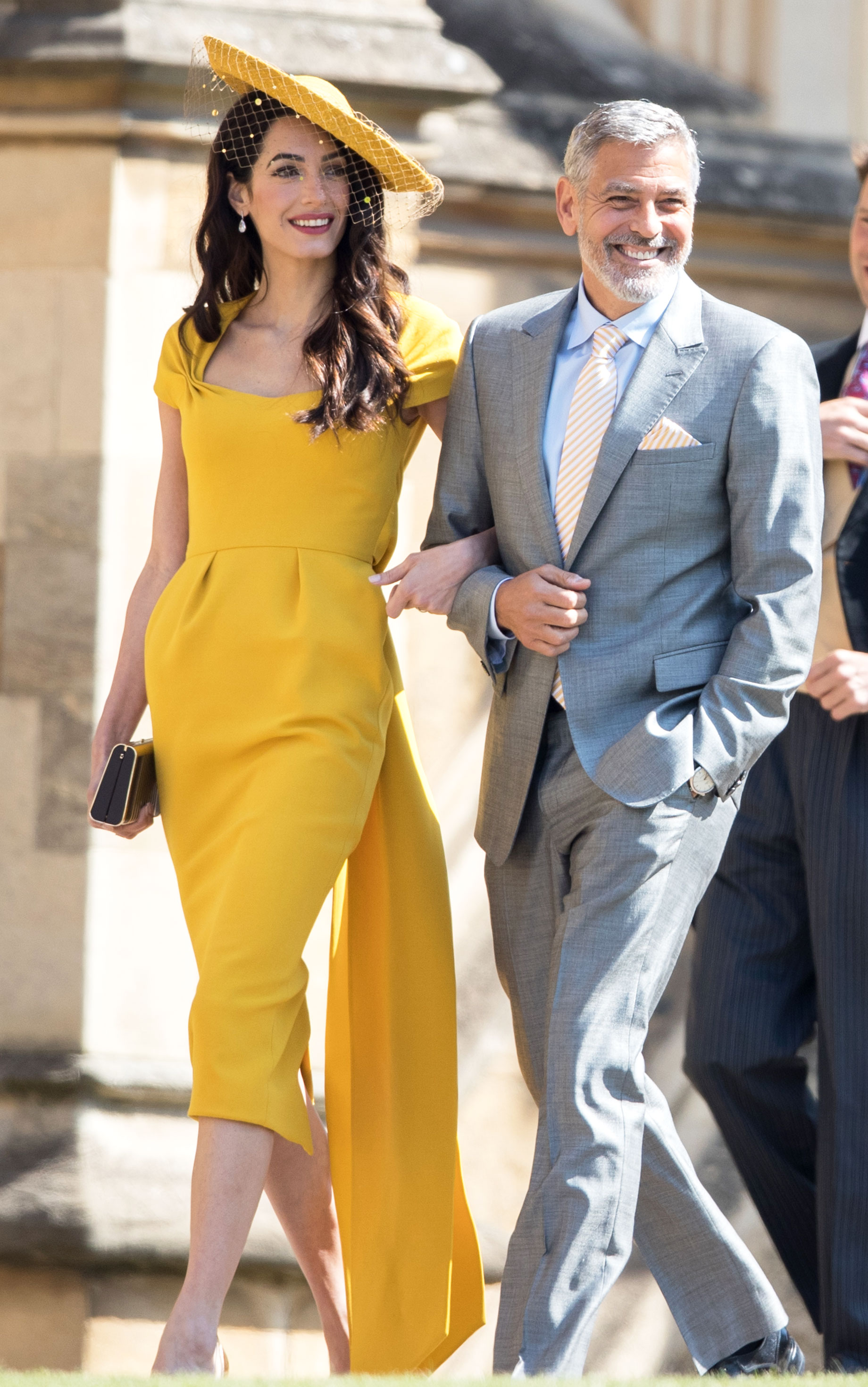 amal-clooney-yellow-dress-to-royal-wedding - George Clooney and Amal Clooney attend the wedding of Prince Harry to Ms Meghan Markle at St George's Chapel