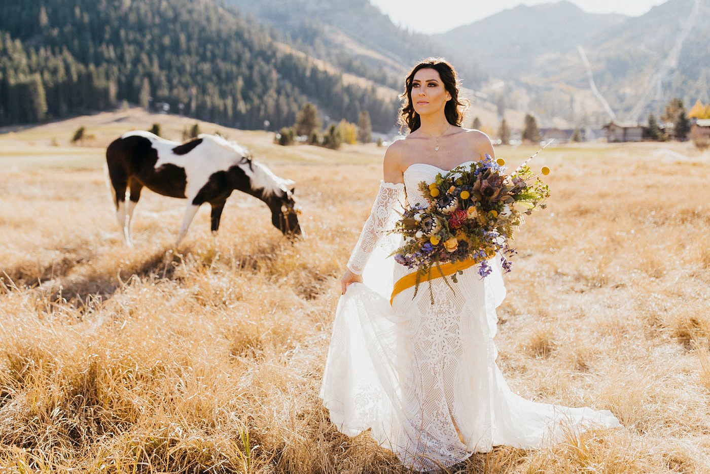 Becca Kufrin Garrett Yrigoyen Pre-Wedding Shoot - The former bearer of red roses held a gorgeous bouquet designed by Love & Lupines as she posed in an open field.
