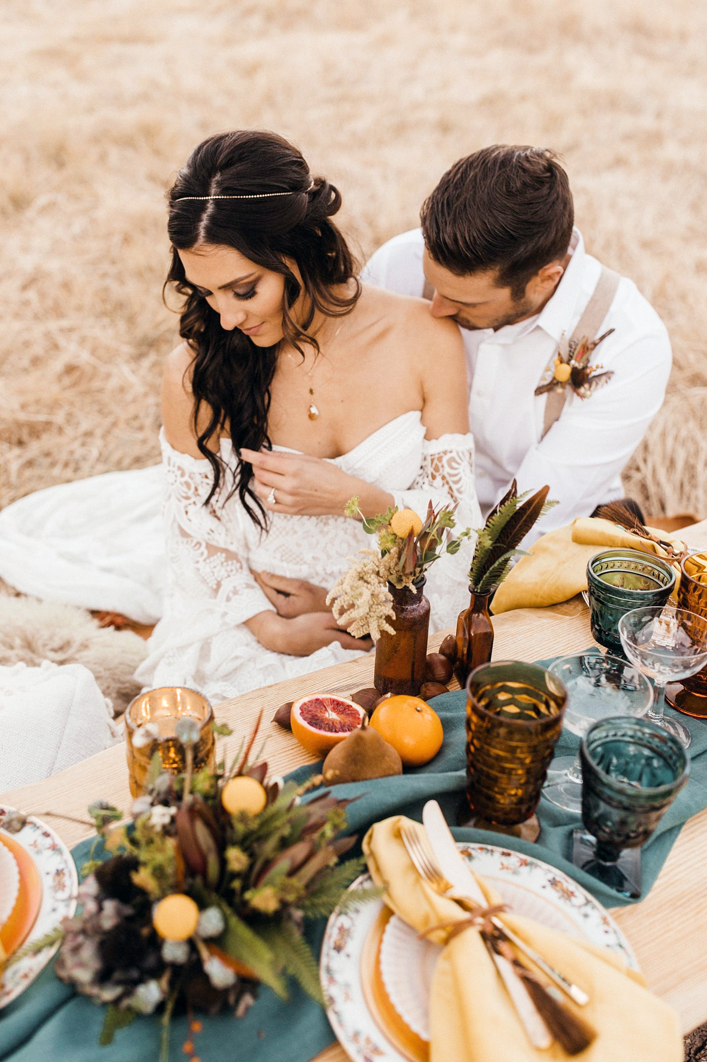 Becca Kufrin Garrett Yrigoyen Pre-Wedding Shoot - The Bachelor Nation fan-favorites sat with their arms wrapped around each other next to a chic Lucky Burro tabletop and a cake made by Delicious Designs .
