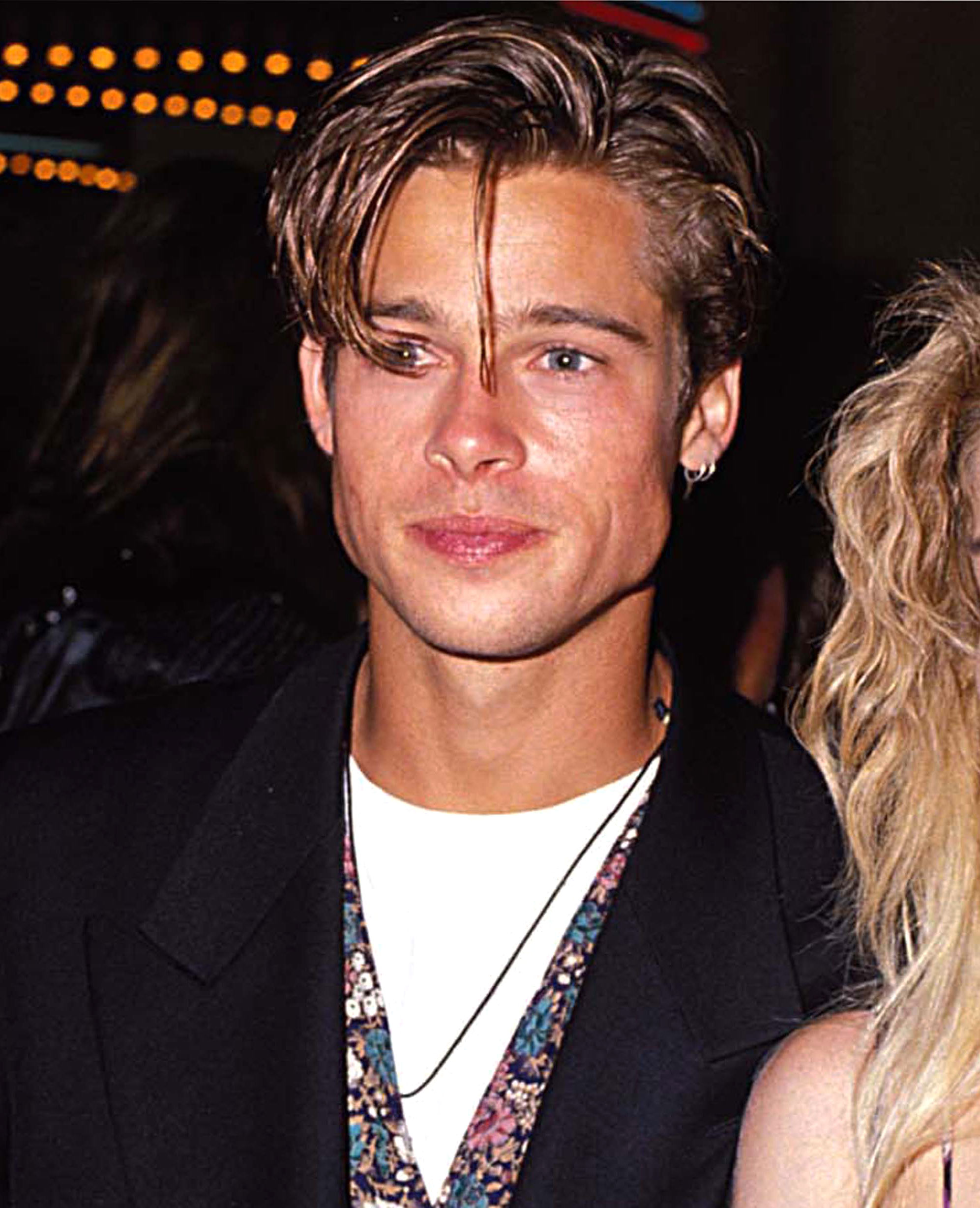 brad-pitt-hair-90s-mtv - The fresh-faced star turned up at the 1990 MTV Video Music Awards with a glossy bowl cut that he managed to make look cool.