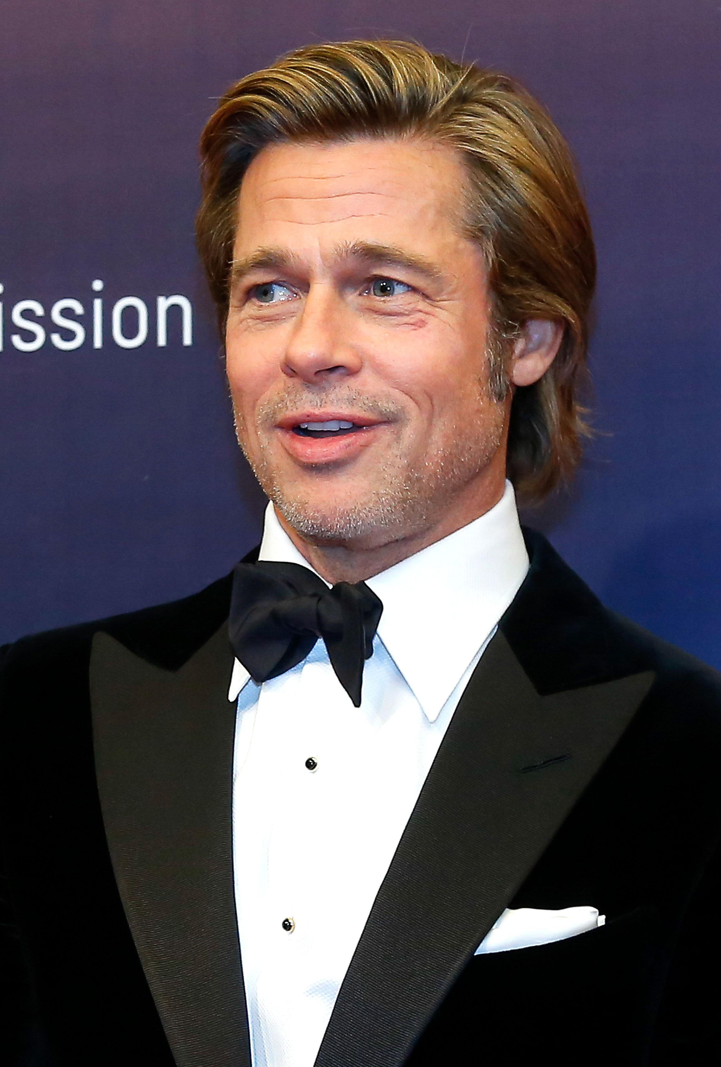 brad-pitt-short hair - In a look that somehow incorporates so many of his previous styles, Pitt appeared at a Breitling event in Beijing with a voluminous side-swept cut and a hint of stubble.
