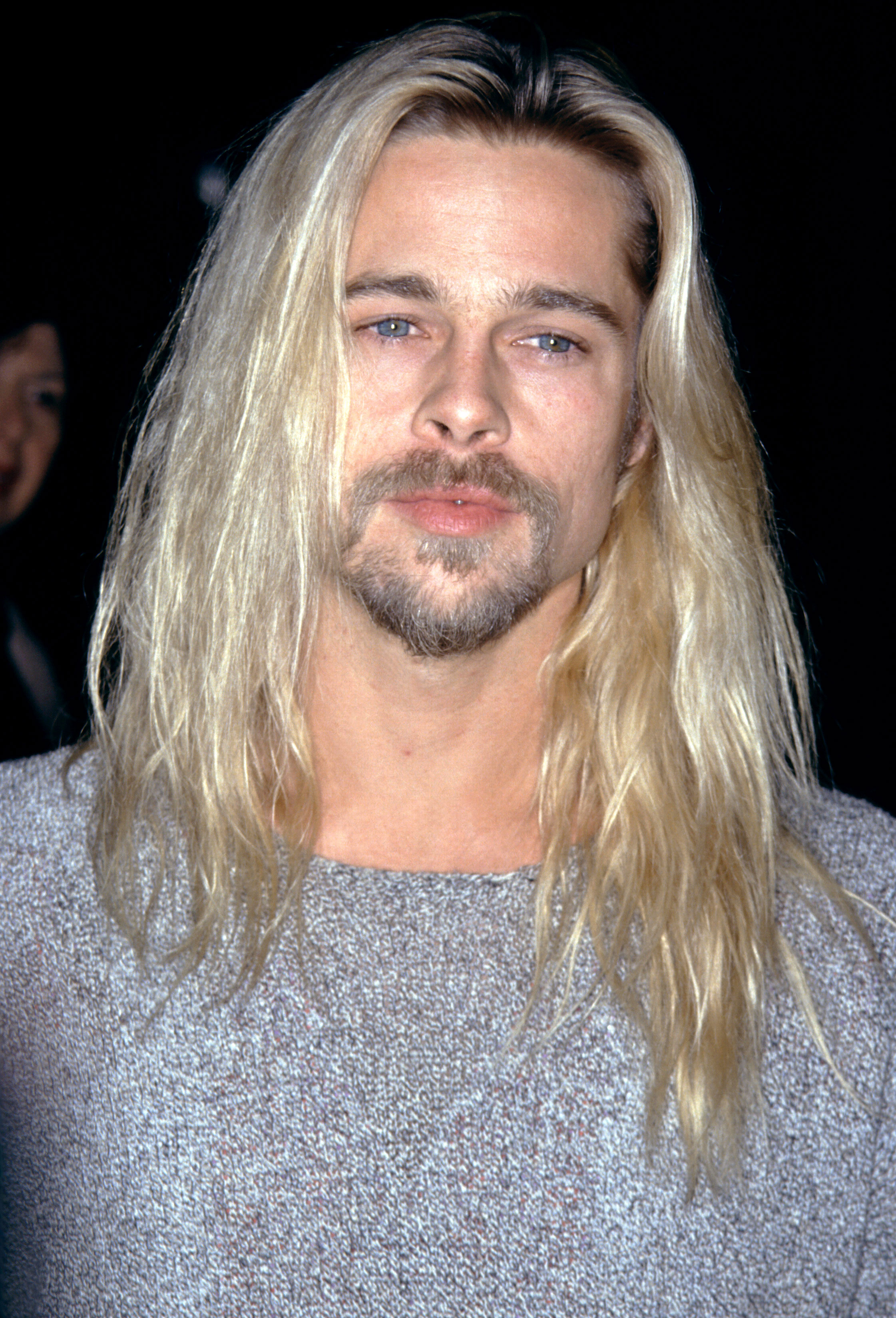 brad-pitt-long hair-2 - At the L.A. premiere of Legends of the Fall , the heartthrob showed off a new bleach blonde color and even longer locks.