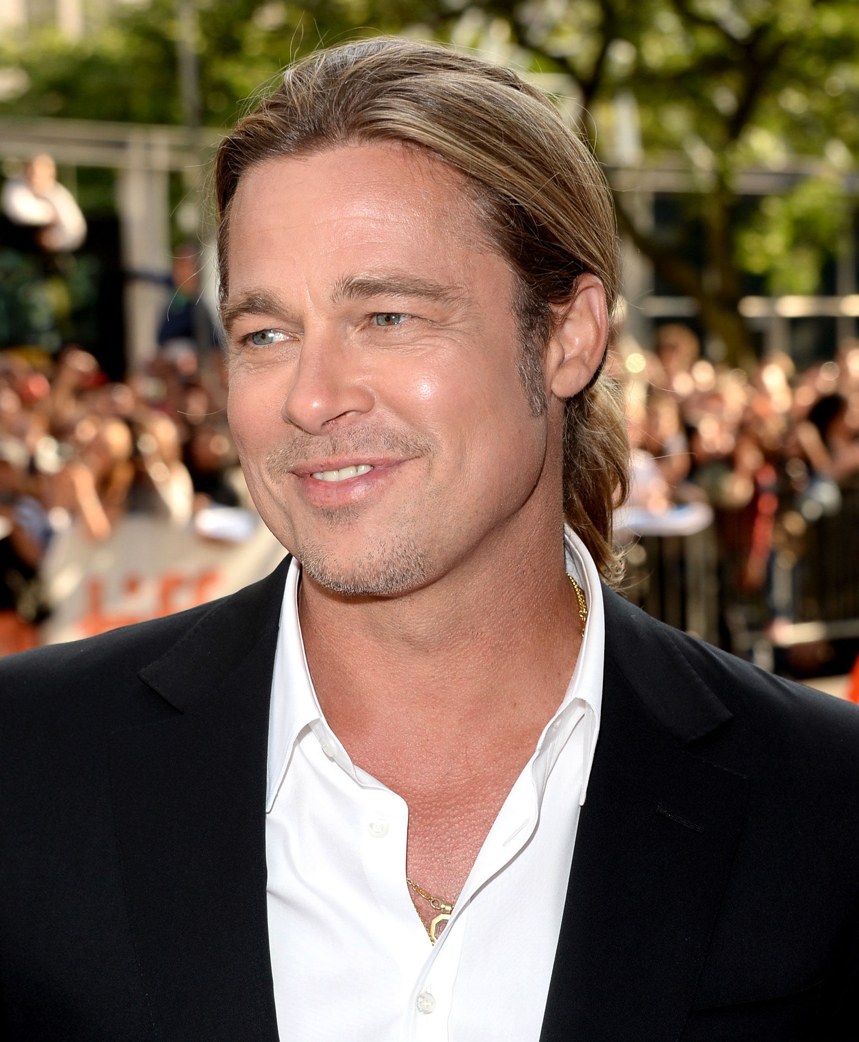 brad-pitt-pony tail hair - Yes, that is the traces of a man bun you see. The 12 Years a Slave star rocked the trendy updo at the 2013 Toronto International Film Festival.