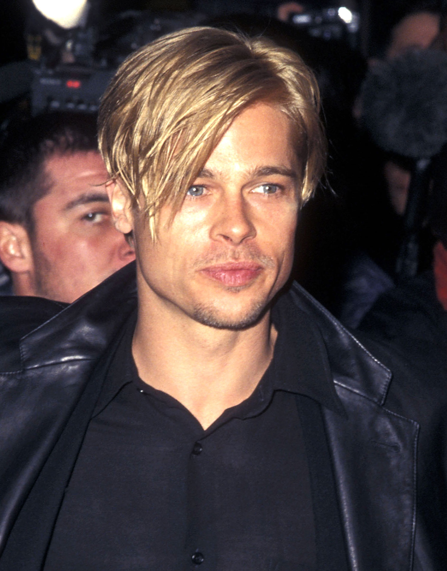brad-pitt-hair 90s - Long before Justin and Hailey Bieber stepped out with similar cuts , Pitt and his then-girlfriend Gwyneth Paltrow rocked matching shaggy pixies at the NYC premiere of The Devil's Own .
