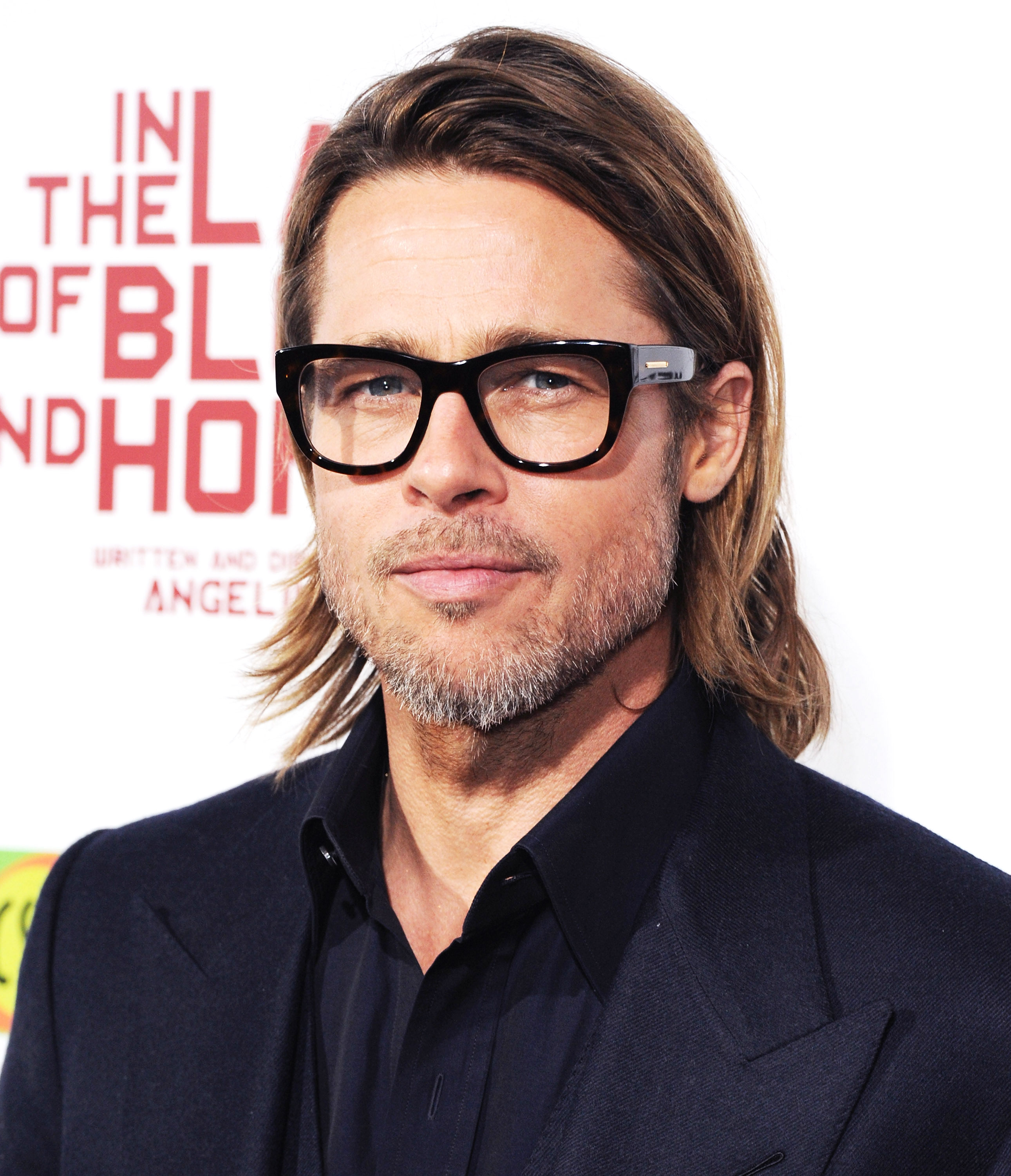 brad-pitt-long hair The Land Of Blood And Honey glasses - Once again embracing a more relaxed vibe, Pitt added a grey-flecked beard to his shoulder-grazing mane at the L.A. premiere of In the Land of Blood and Honey .