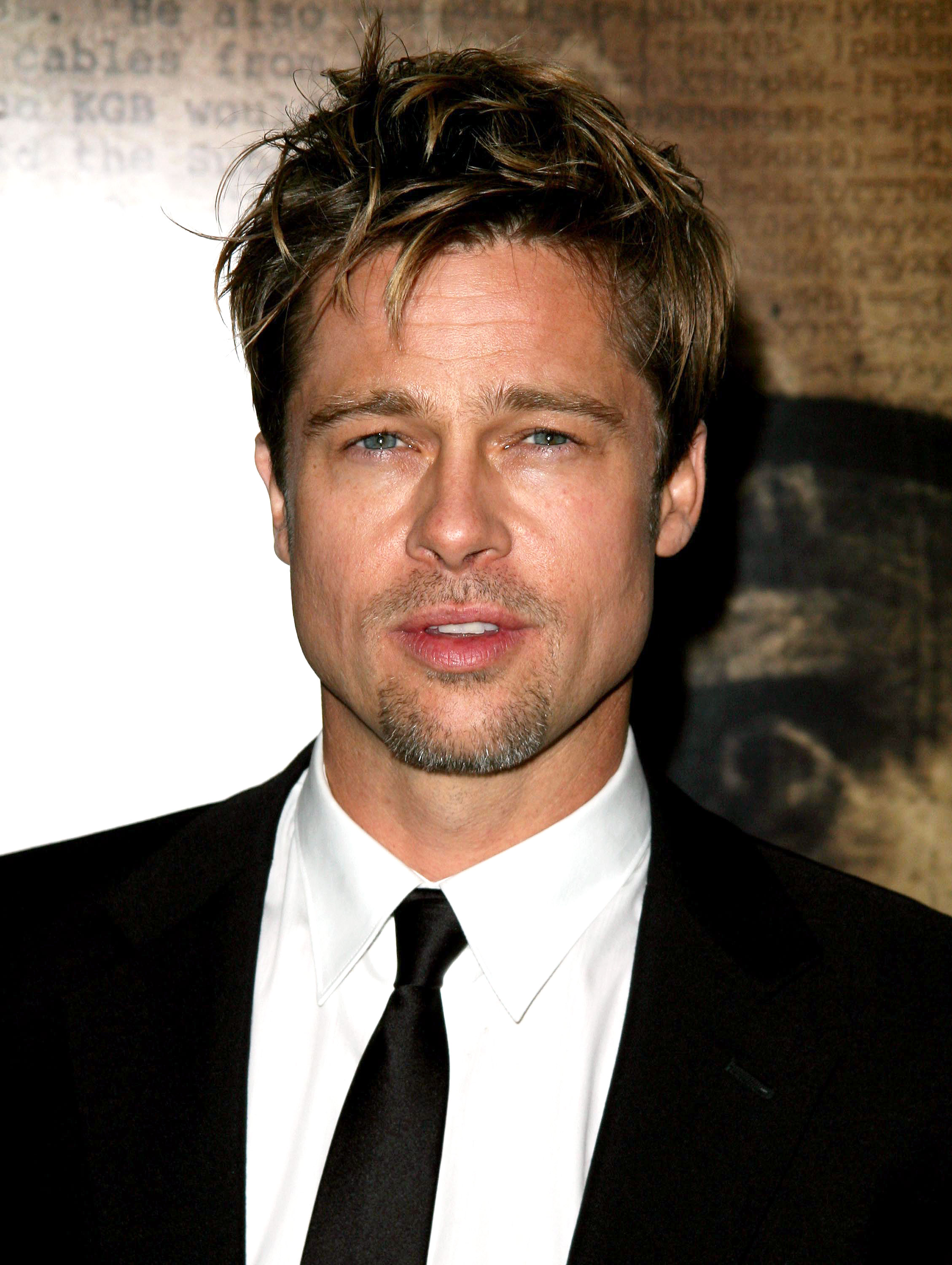 brad-pitt-hair- - This tousled sun-kissed crop from The Good Shepherd premiere in NYC is peak Pitt.