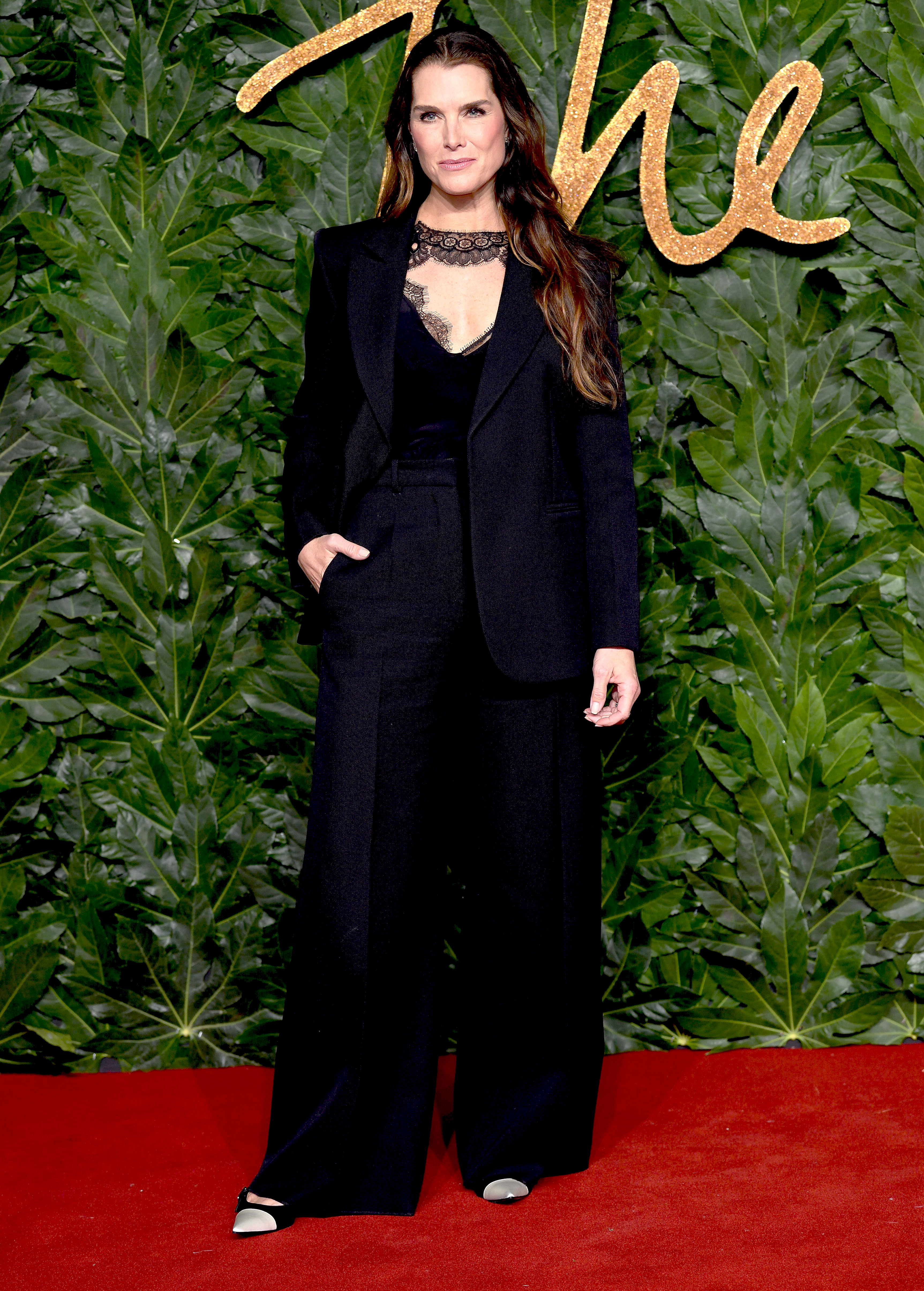 brooke-shields - The catwalk queen was all kinds of boss lady chic in a lace-trimmed Victoria Beckham suit.