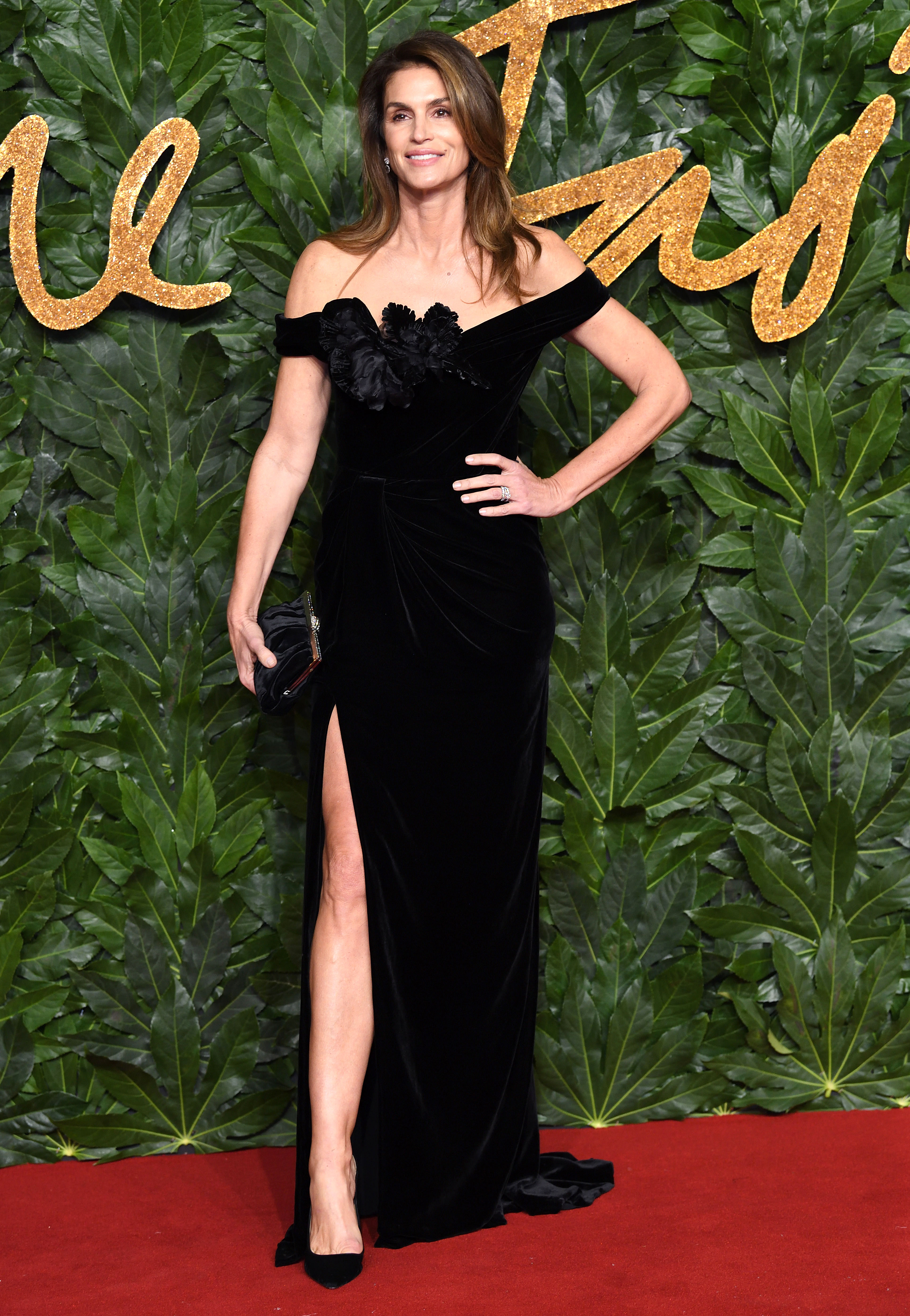 cindy-crawford - The ageless model showed some leg in flower-adorned off-the-shoulder Marchesa gown.