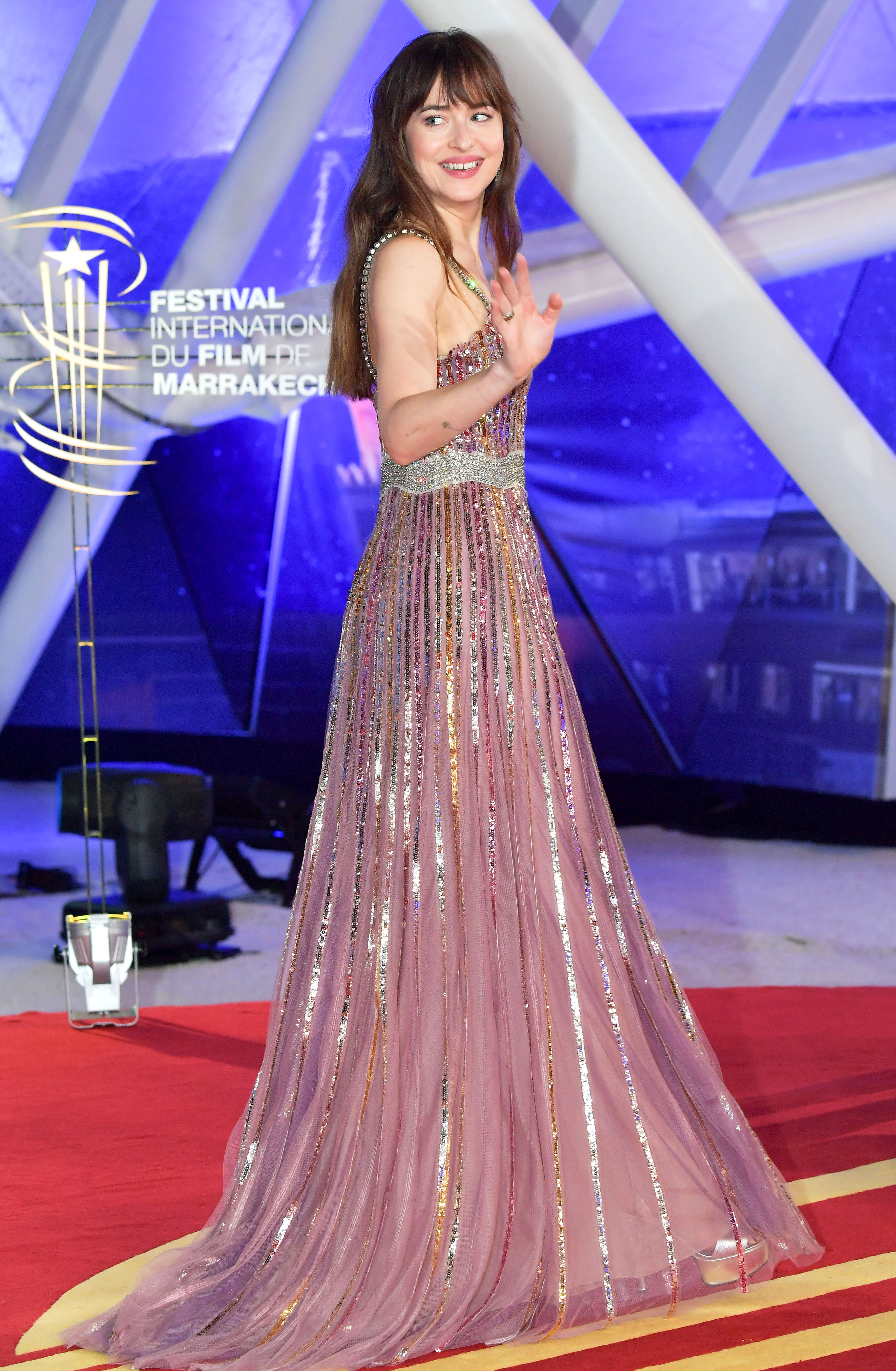 dakota-johnson - Starting things off on a high note, the actress was thinking pink in a sparkly mauve Gucci gown and Messika Jewelry at the opening ceremony on Friday, November 30.