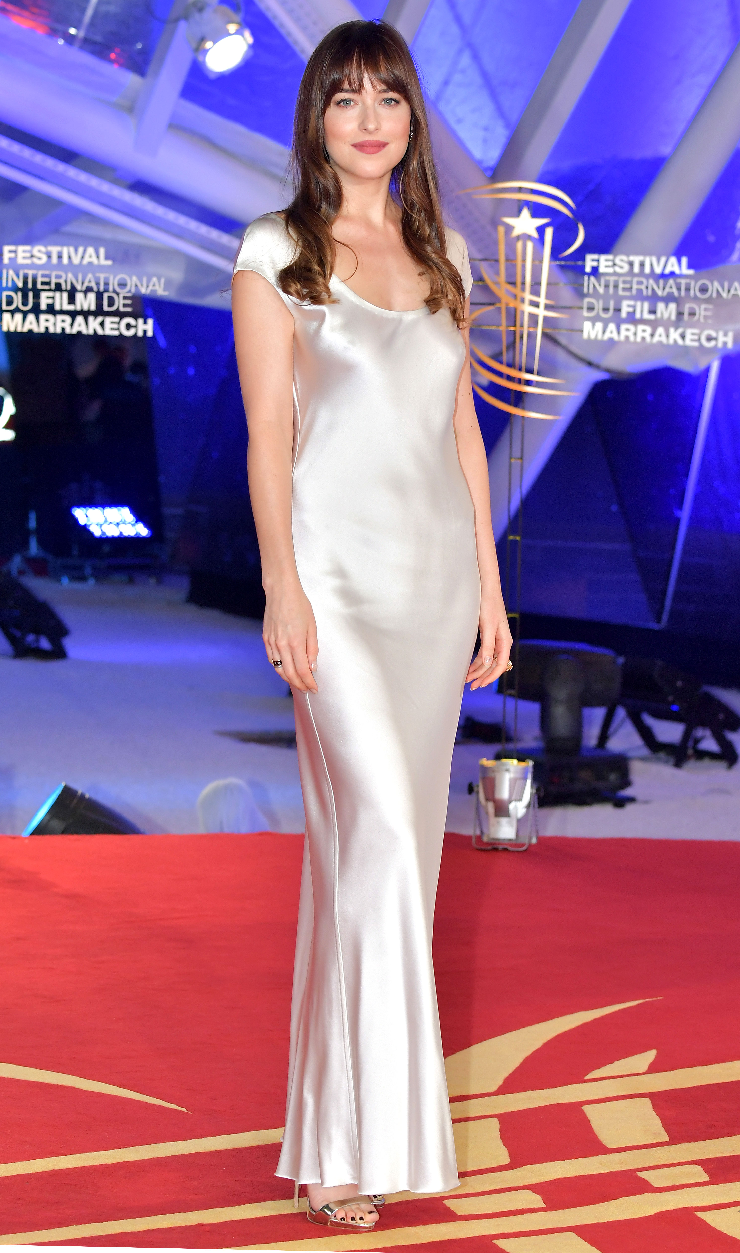 dakota-johnson - It was all about the sexy slip dress for the jurist at an event on Sunday, December 2, in a short-sleeve Bevza design that she paired with Cartier jewelry and Giuseppe Zanotti sandals.
