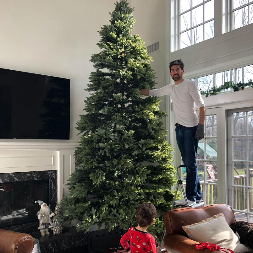"stars go all out with holiday decorations gallery - ""Had a bit of a Griswold moment this weekend with our tree,"" the Good Morning America meteorologist captioned a pic of her husband looking a bit overwhelmed on a ladder by their tree. ""We love it though! Going HOLIDAY HUGE with @benaarontv #dadthattreewontfitinourbackyard - note, our tree isn't real and we did decorate (ben has fully decorated video :) )"""