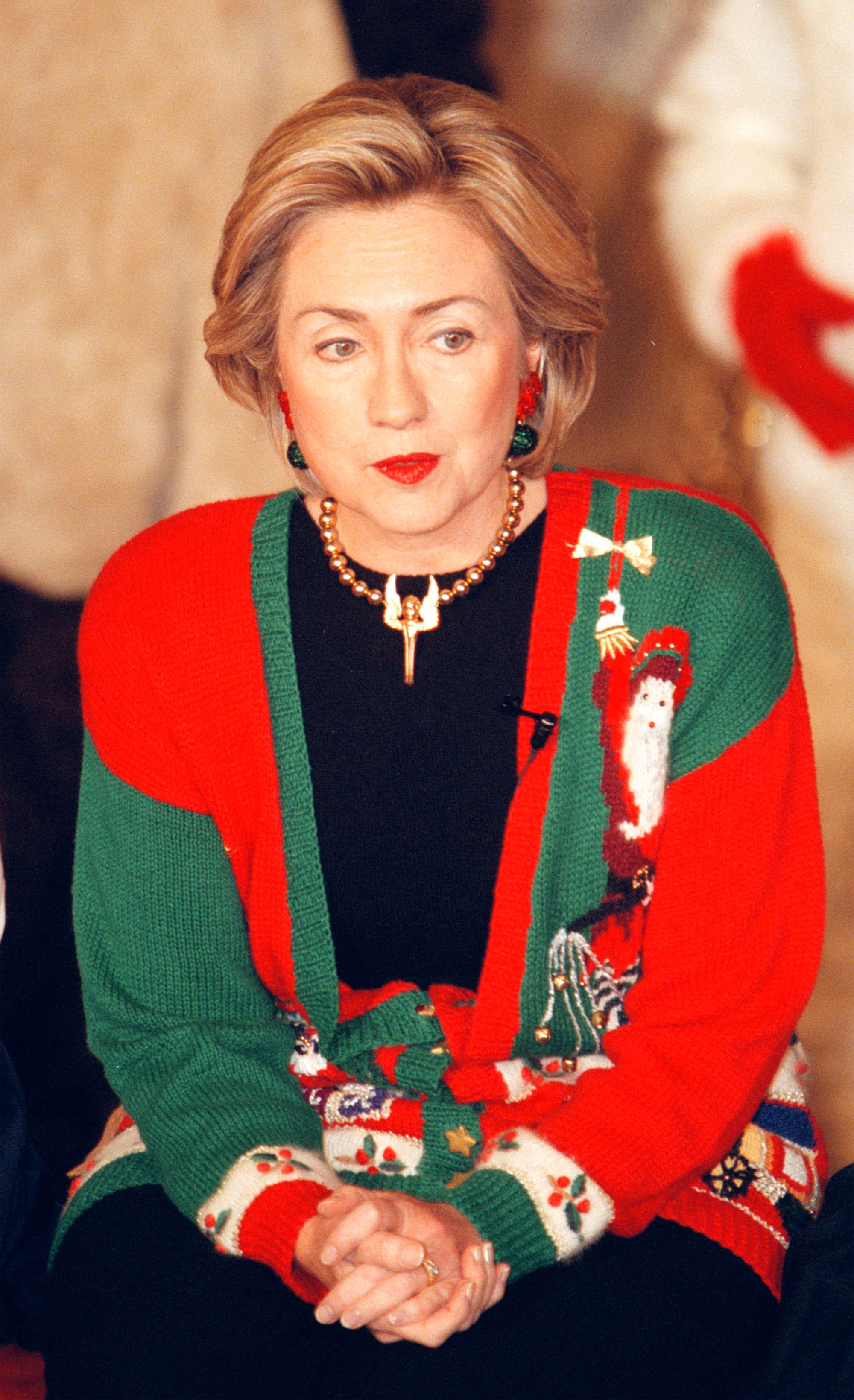 """celebrity ugly christmas sweater - 96 Normal 0 false false false EN-US X-NONE X-NONE /* Style Definitions */ table. MsoNormalTable {mso-style-name:""""Table Normal""""; mso-tstyle-rowband-size:0; mso-tstyle-colband-size:0; mso-style-noshow:yes; mso-style-priority:99; mso-style-parent:""""""""; mso-padding-alt:0in 5.4pt 0in 5.4pt; mso-para-margin:0in; mso-para-margin-bottom:.0001pt; mso-pagination:widow-orphan; font-size:12.0pt; font-family:""""Calibri"""",sans-serif; mso-ascii-font-family:Calibri; mso-ascii-theme-font:minor-latin; mso-hansi-font-family:Calibri; mso-hansi-theme-font:minor-latin;} The former secretary of state sported a colorful cardigan while reading A Night Before Christmas to children at the White House with Bill Clinton in 1998."""