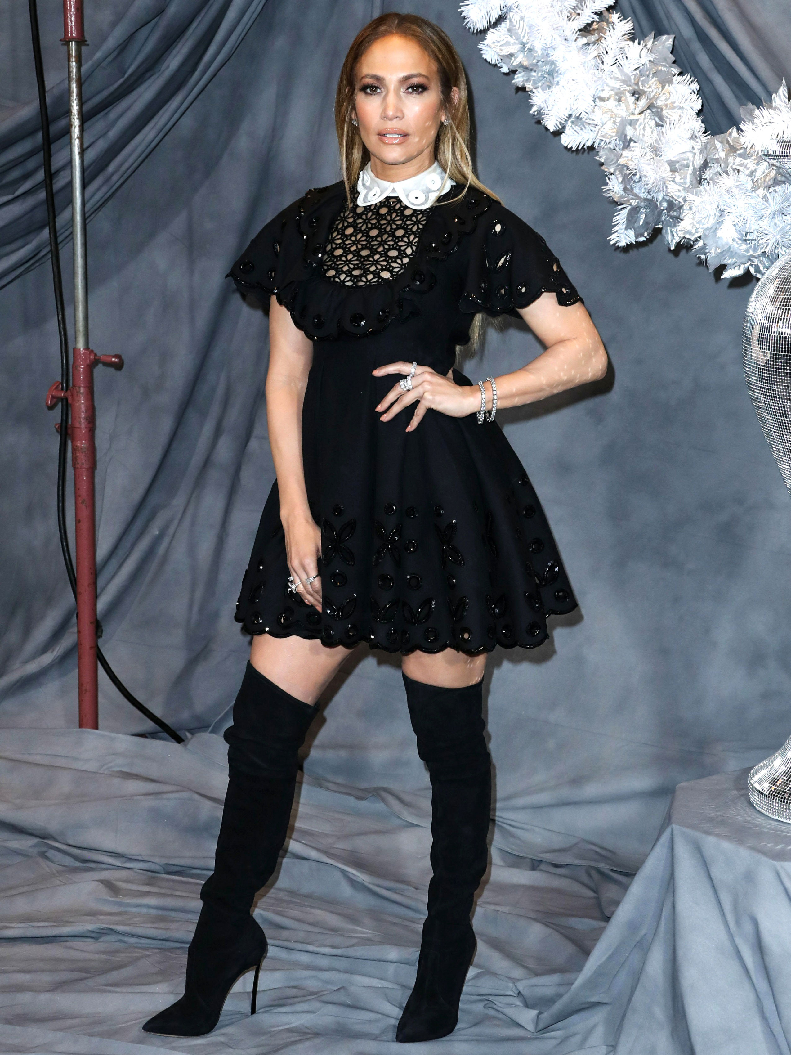 jennifer-lopez-Second-Act-press - Kicking off the press tour in L.A. on Sunday, December 9, the actress showed some leg in an embellished Valentino mini and Casadei over-the-knee boots.