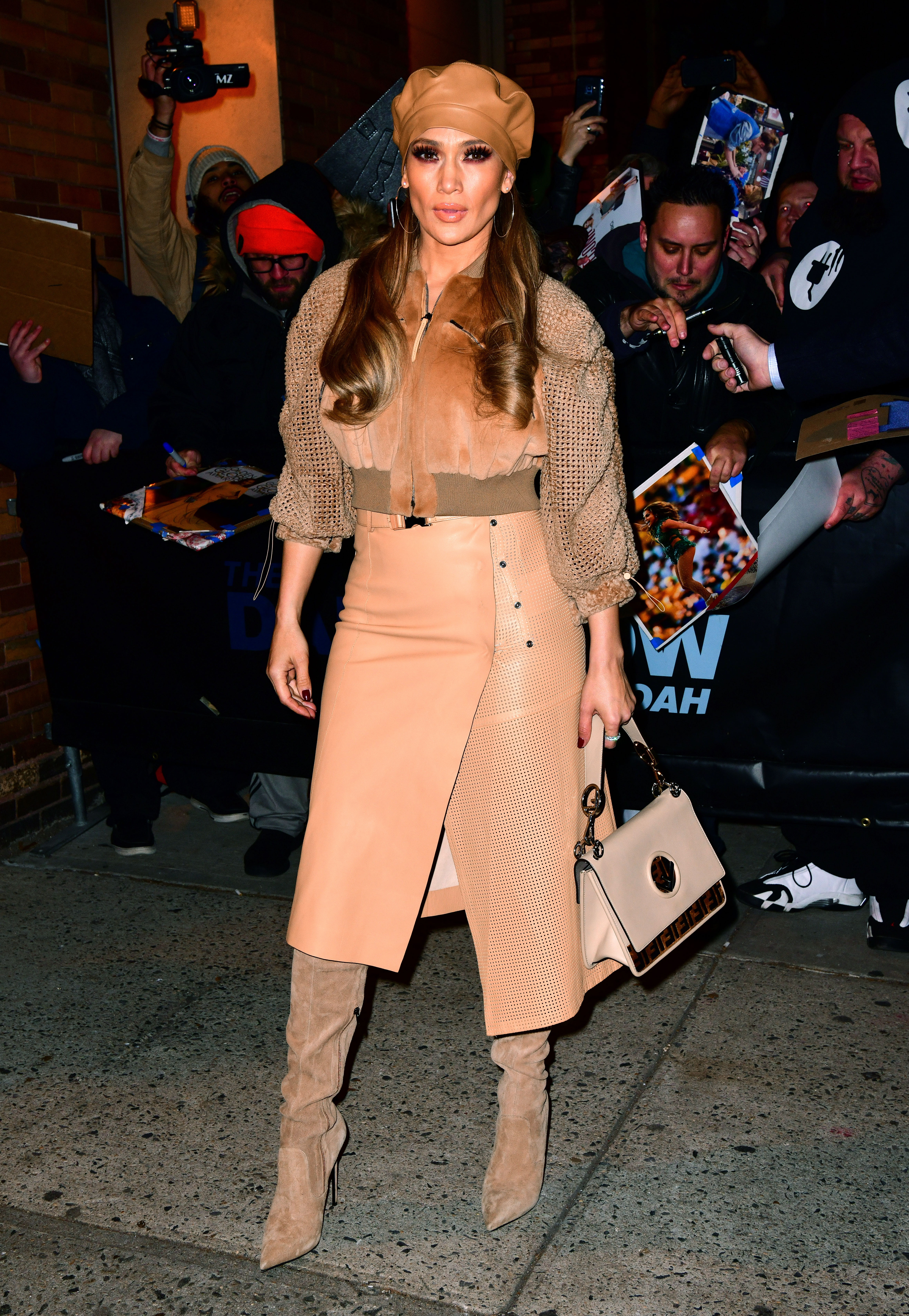 """jennifer-lopez-Second-Act-press-tan-outfit - Who said beige is boring? The """"All I Have"""" songstress departed her Daily Show With Trevor Noah interview on Tuesday, December 11, in head-to-toe Fendi."""