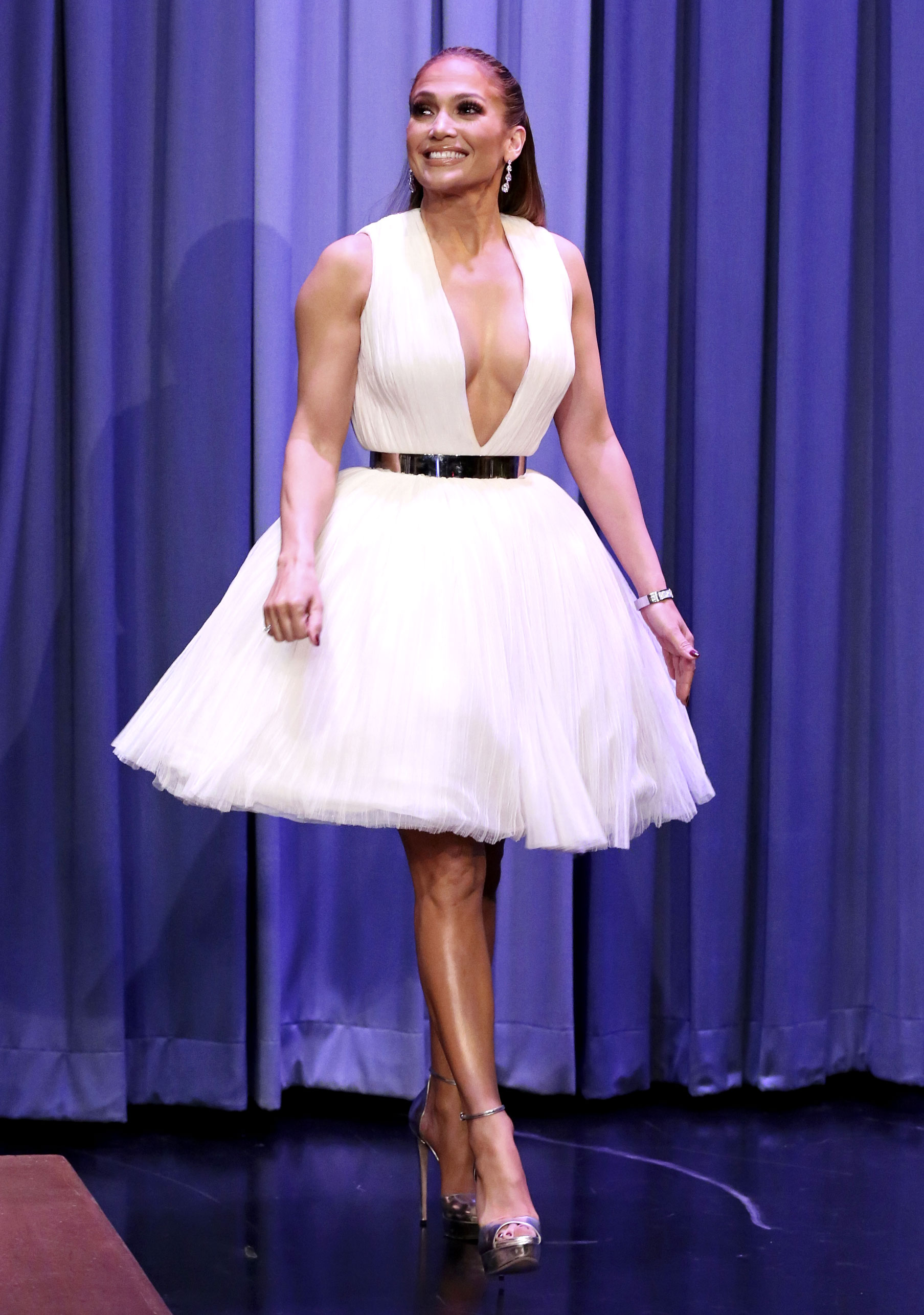 jennifer-lopez-Second-Act-press-white-tutu-dress - For an appearance on the Tonight Show Starring Jimmy Fallon on Tuesday, December 11, the World of Dance judge kept things short and sweet in a tutu-like Saiid Kobeisy mini and Jimmy Choo platforms.