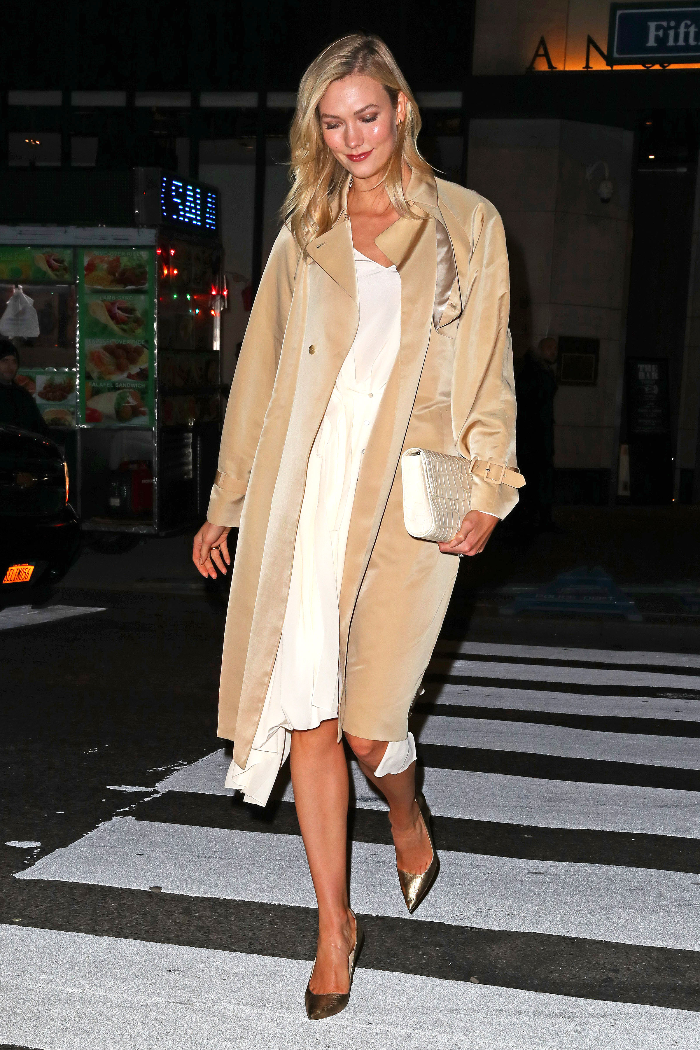 karlie-kloss-beige-coat - Leaving a dinner in NYC on Monday, December 10, the newlywed stunned in a drapey white dress and matching coat.