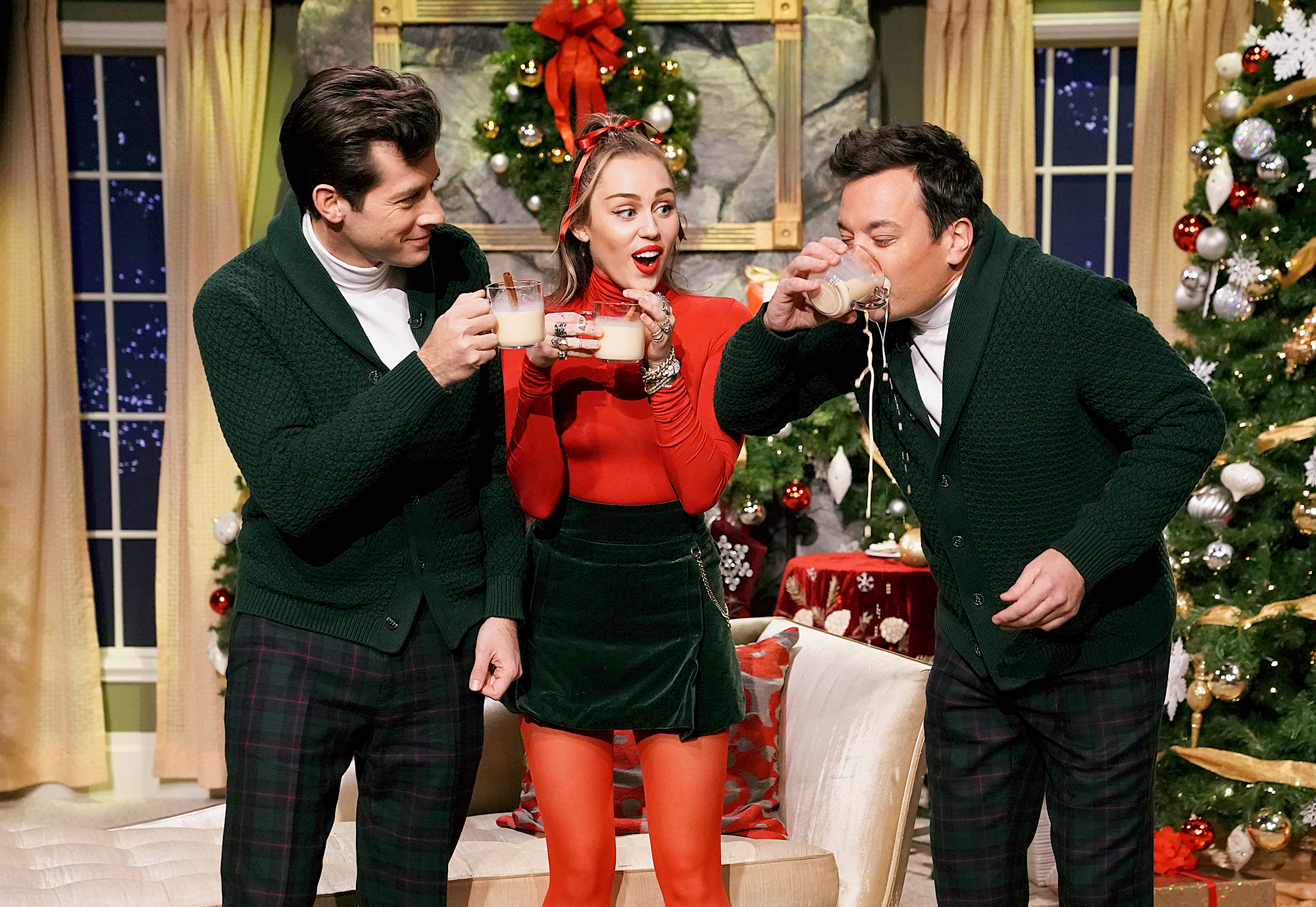 """mark-ronson-miley-cyrus-jimmy-fallon - THE TONIGHT SHOW STARRING JIMMY FALLON — Episode 0986 — Pictured: (l-r) Musician Mark Ronson, singer Miley Cyrus, and host Jimmy Fallon during """"Santa Baby"""" on December 20, 2018 — (Photo by: Andrew Lipovsky/NBC/NBCU Photobank)"""