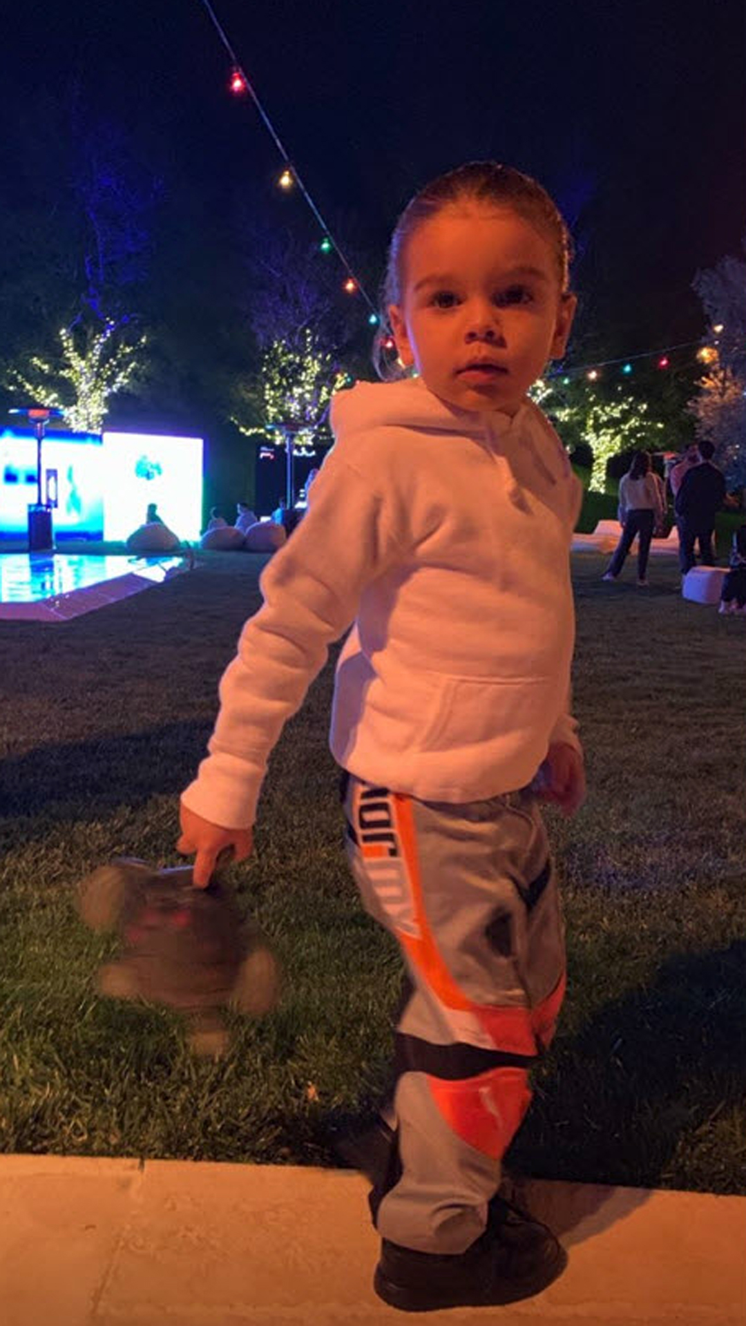 Kourtney Throws Sons a Fortnite-Themed Birthday Party - Mason was joined by younger brother, Reign, whom he shares a birthday with. Reign looked adorable in a sporty outfit with his hair pulled back in a ponytail.
