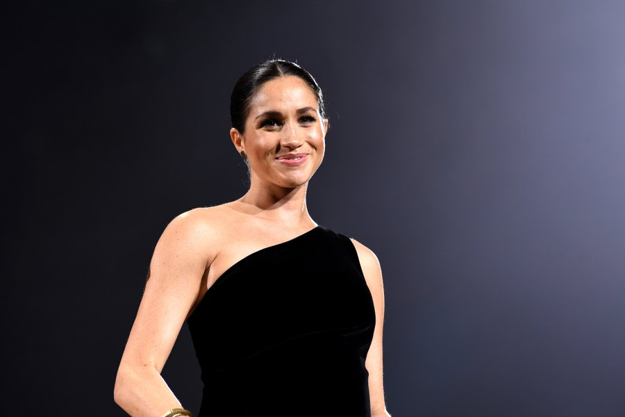 Pregnant Duchess Meghan Stuns in Black, Cradles Her Baby Bump at 2018 Fashion Awards: Pics