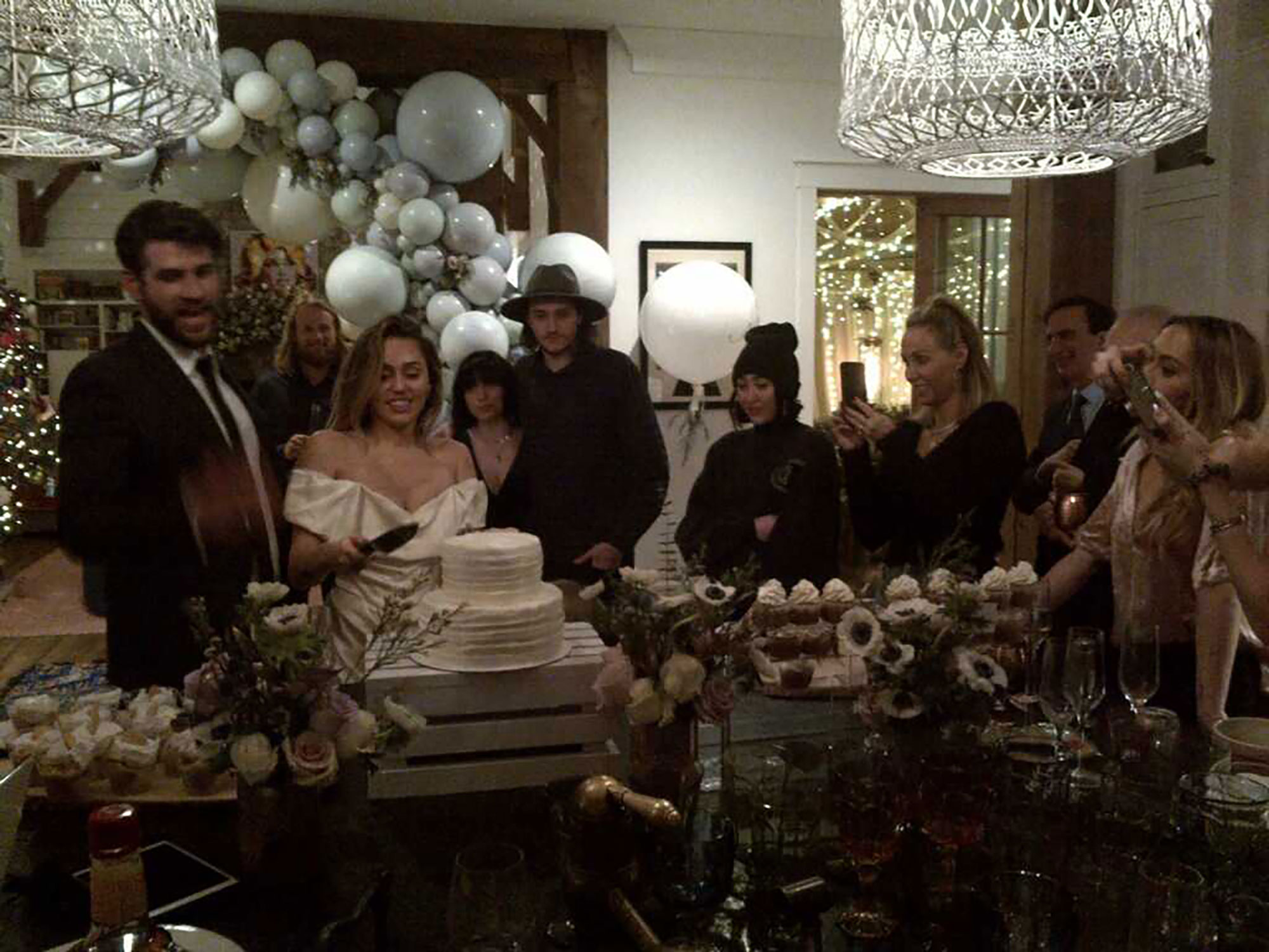 """Inside Miley Cyrus and Liam Hemsworth's Secret Wedding: Pics - Billy Ray shared a photo of the Cyrus and Hemsworth families watching the newly married couple cut their cake. """"Wedding wouldn't be complete with out one shot from Dads out dated blackberry camera,"""" the """"Achy Breaky Heart"""" crooner captioned the pic via Twitter ."""