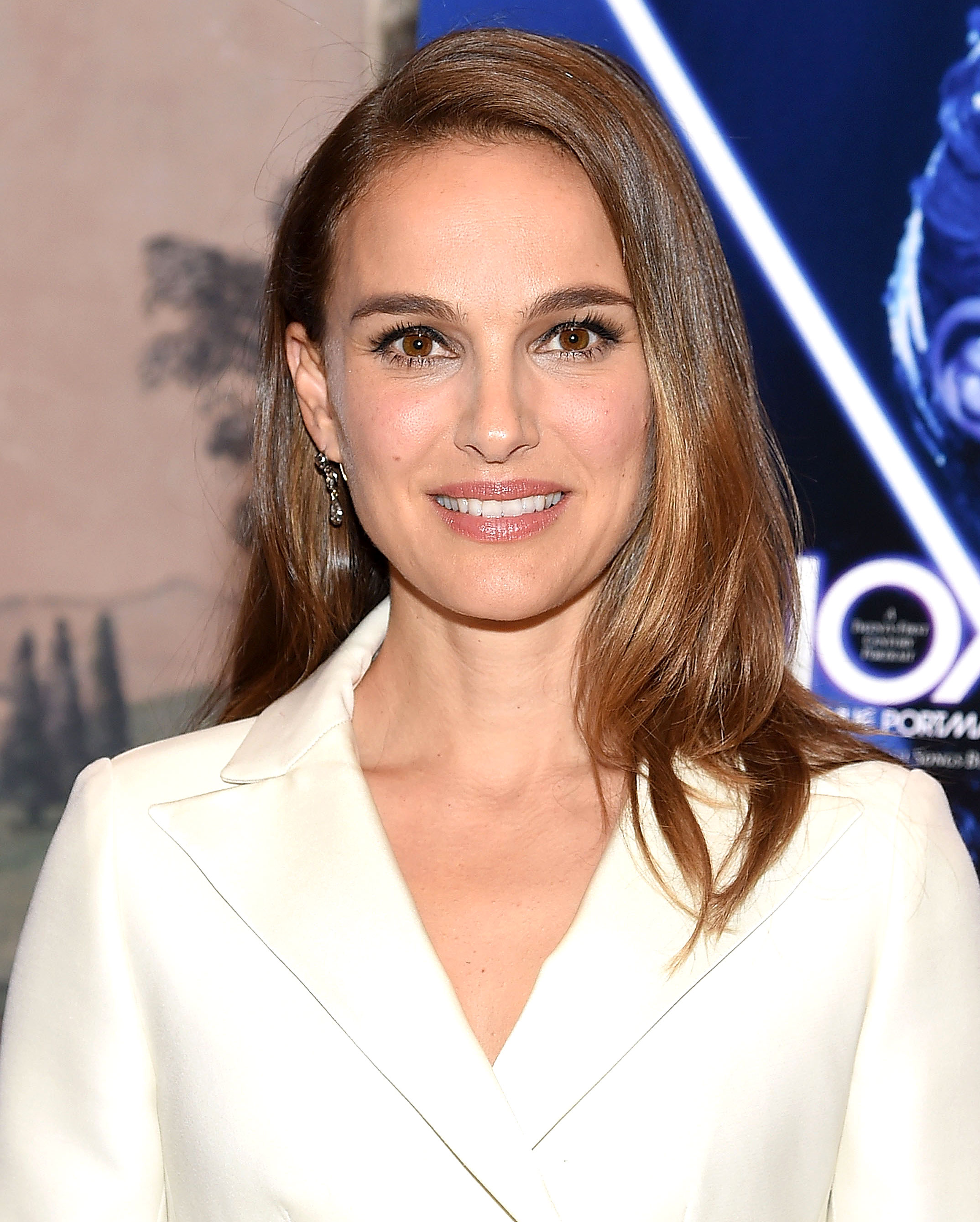 natalie-portman-side-hair-part - While you may be conditioned to believe a perfectly sculpted complexion requires dozens of products, makeup artist Quinn Murphy gave the actress a natural contour in just two steps at a Vox Lux screening in NYC on Thursday, December 13. On Instagram, he shared that he first applied a sheer veil of the Dior Backstage Face & Body Foundation to even out her skin tone, before swapping blush for bronzer and using the DiorSkin Mineral Nude Bronze 003 along her temples, in the hollows of the cheek and on the tip of the chin for a sun kissed effect.
