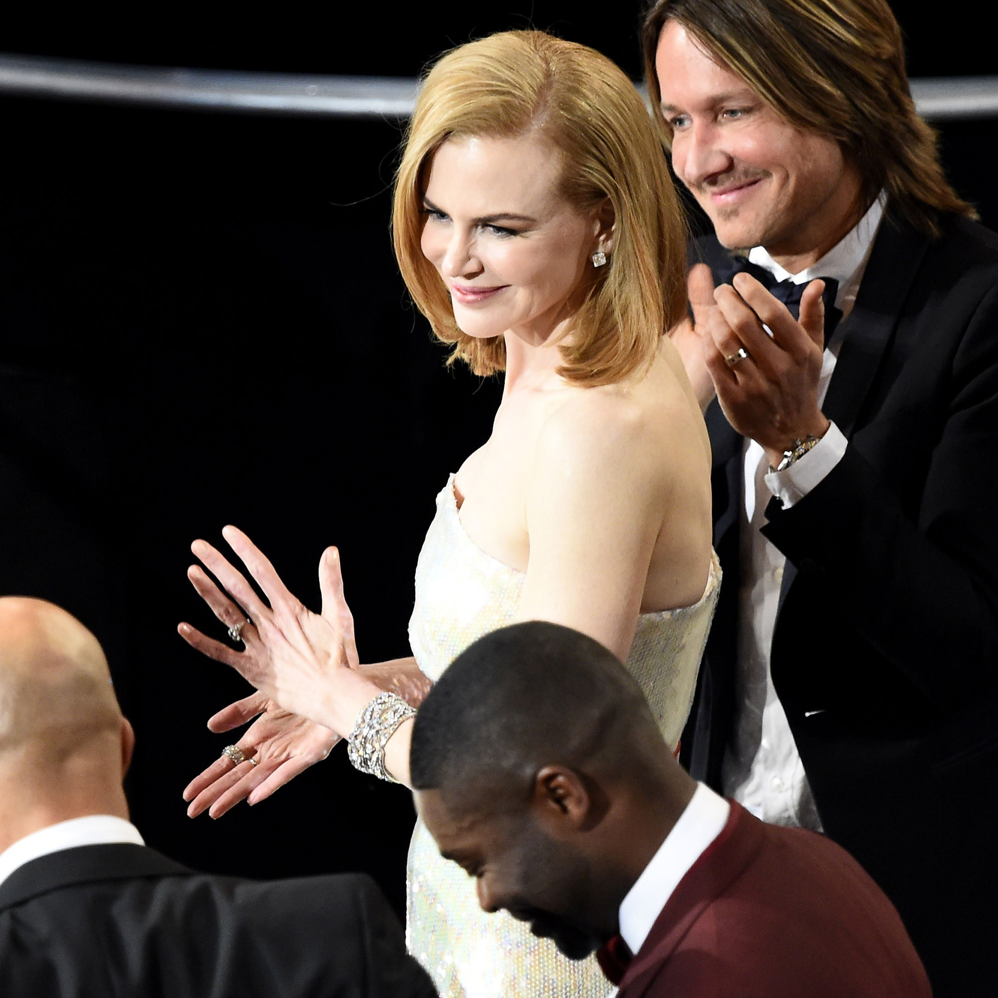 "A Look Back at All the Times Nicole Kidman Has Clapped Like a Seal: Watch - Actress Nicole Kidman and musician Keith Urban applaud as actor David Oyelowo (R) looks on while musicians Common (C) and John Legend (L) make it to the stage to accept the Oscar for Best Original Song ""Glory"" (Selma) at the 87th Oscars February 22, 2015 in Hollywood, California."