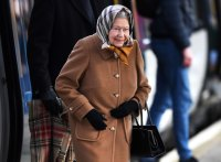The Queen wraps up warm as she takes train to Norfolk for annual Christmas break